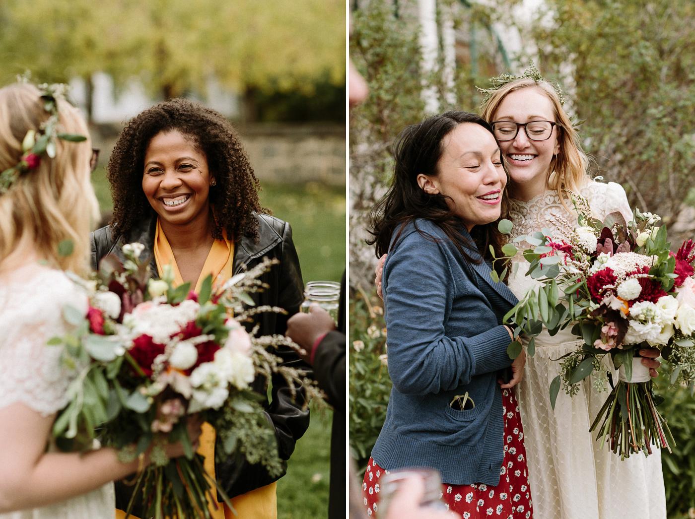 Wedding guests hugging bride