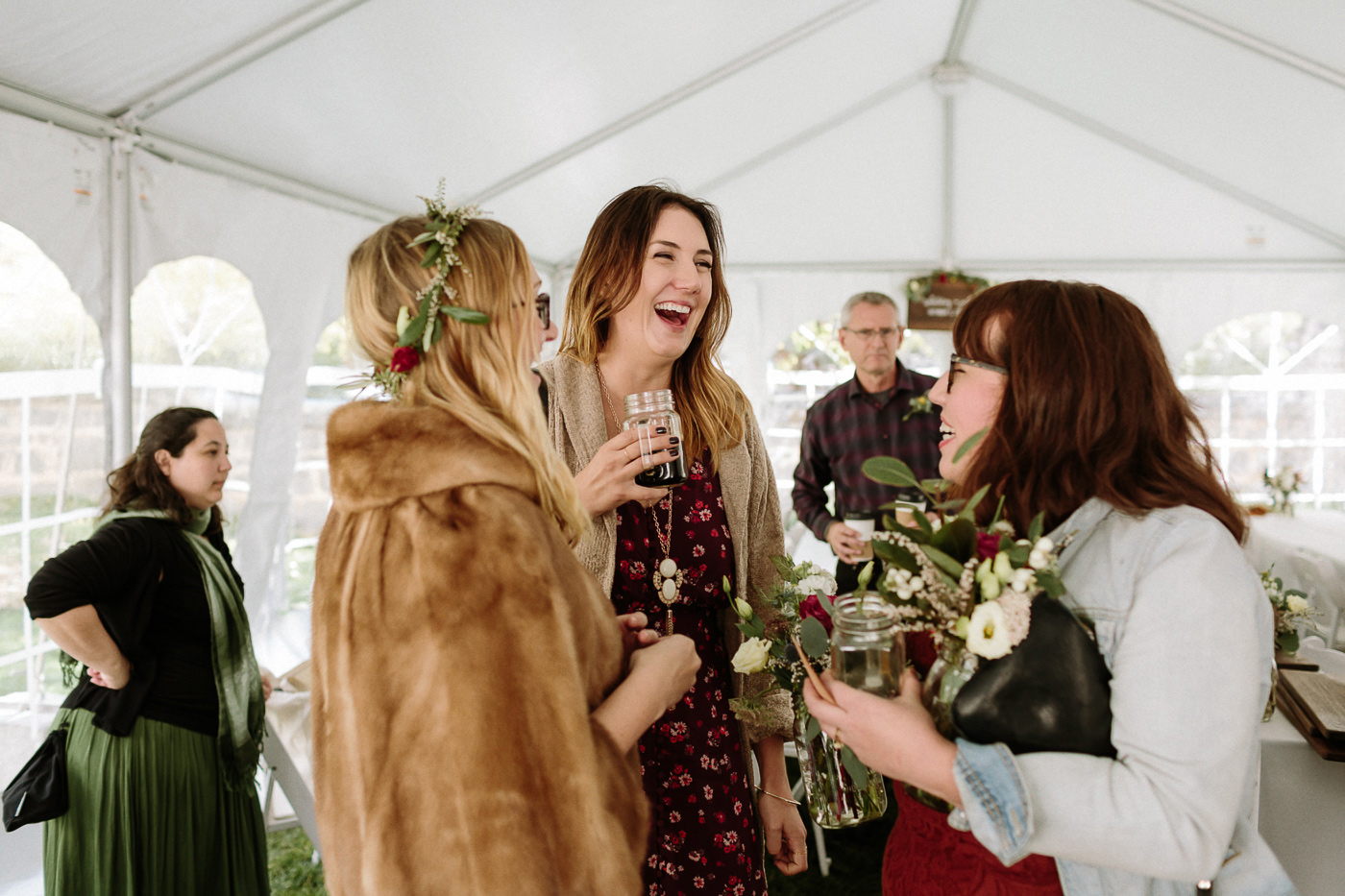 Reception guests laughing with bride