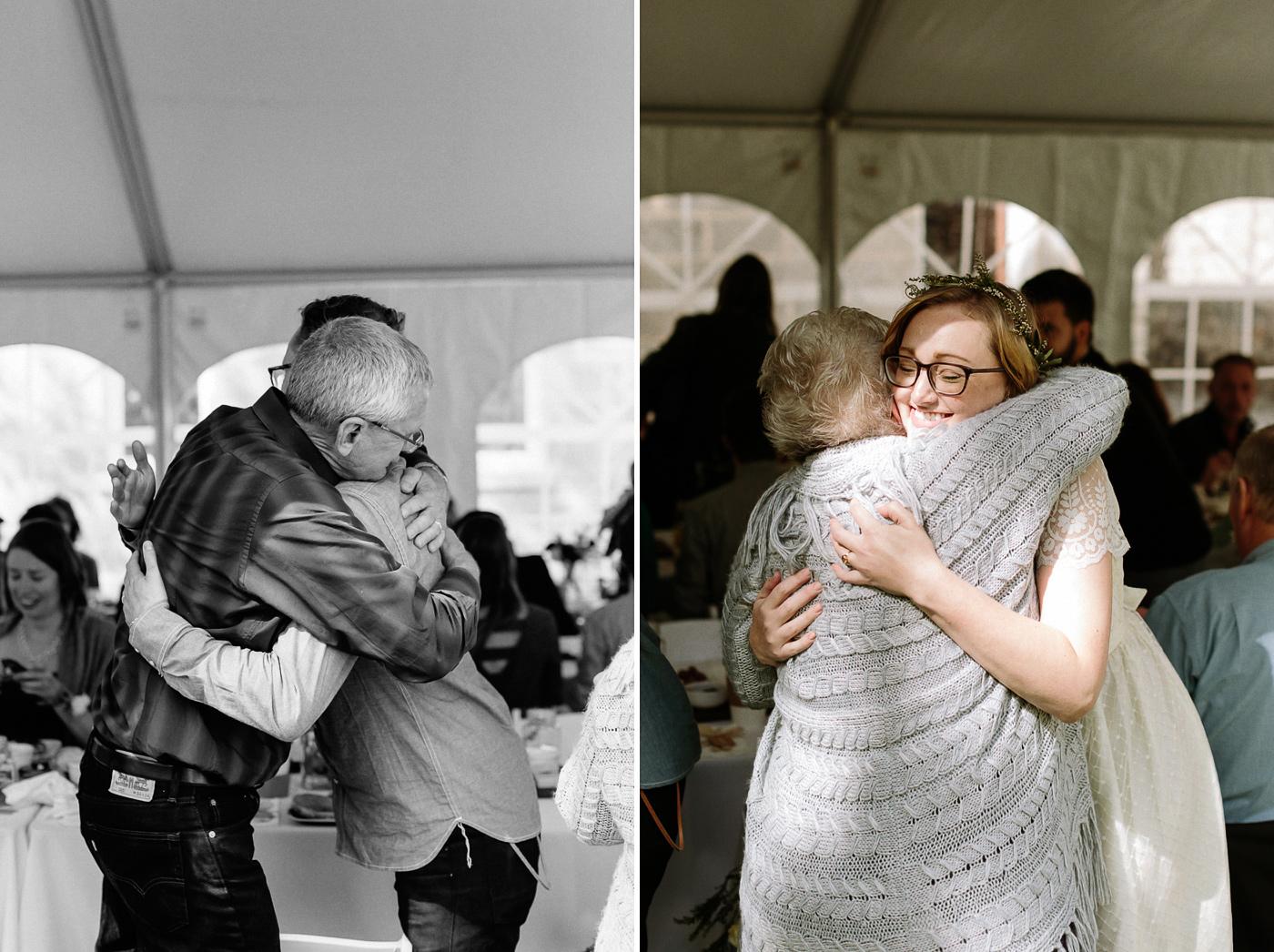 Bride and groom hugging parents