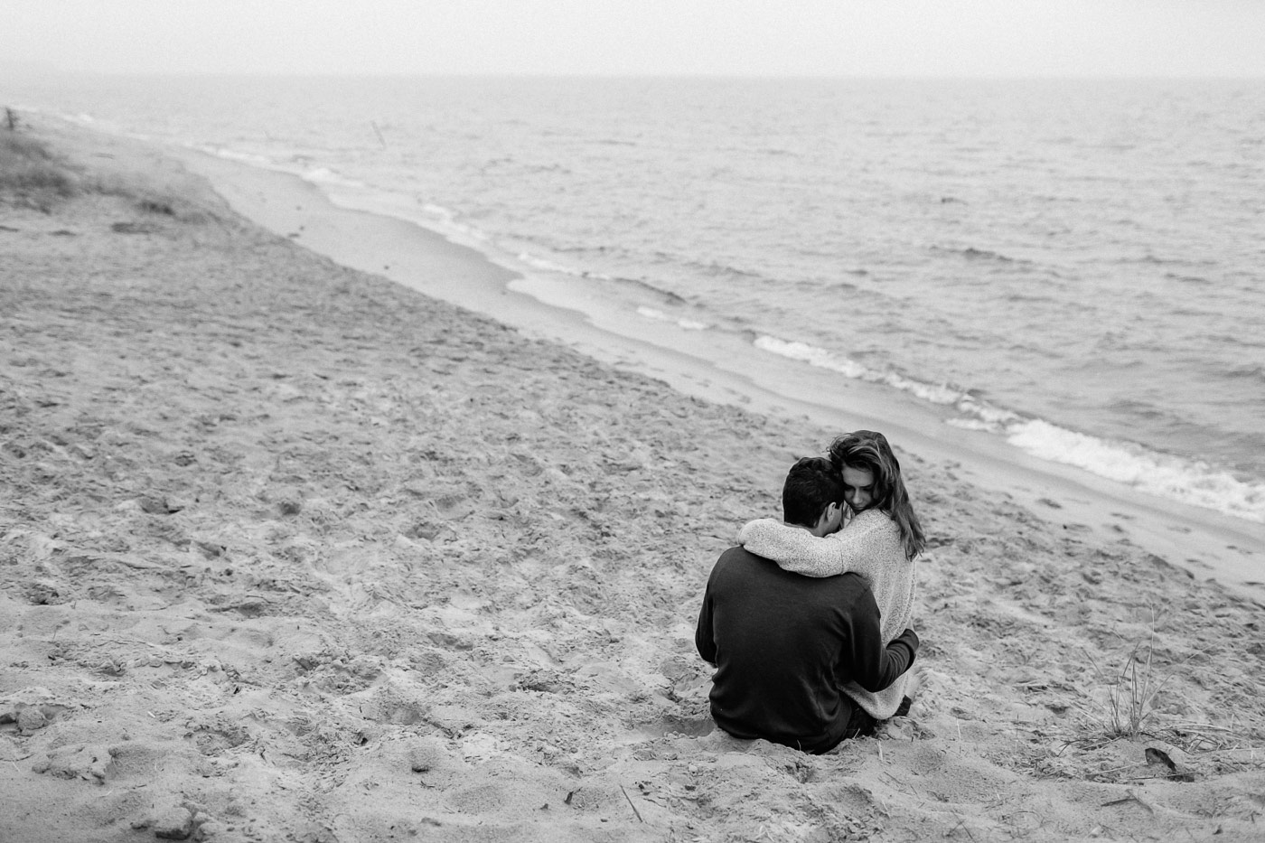Couple hugging in the sand at Saugatuck Dunes State Park