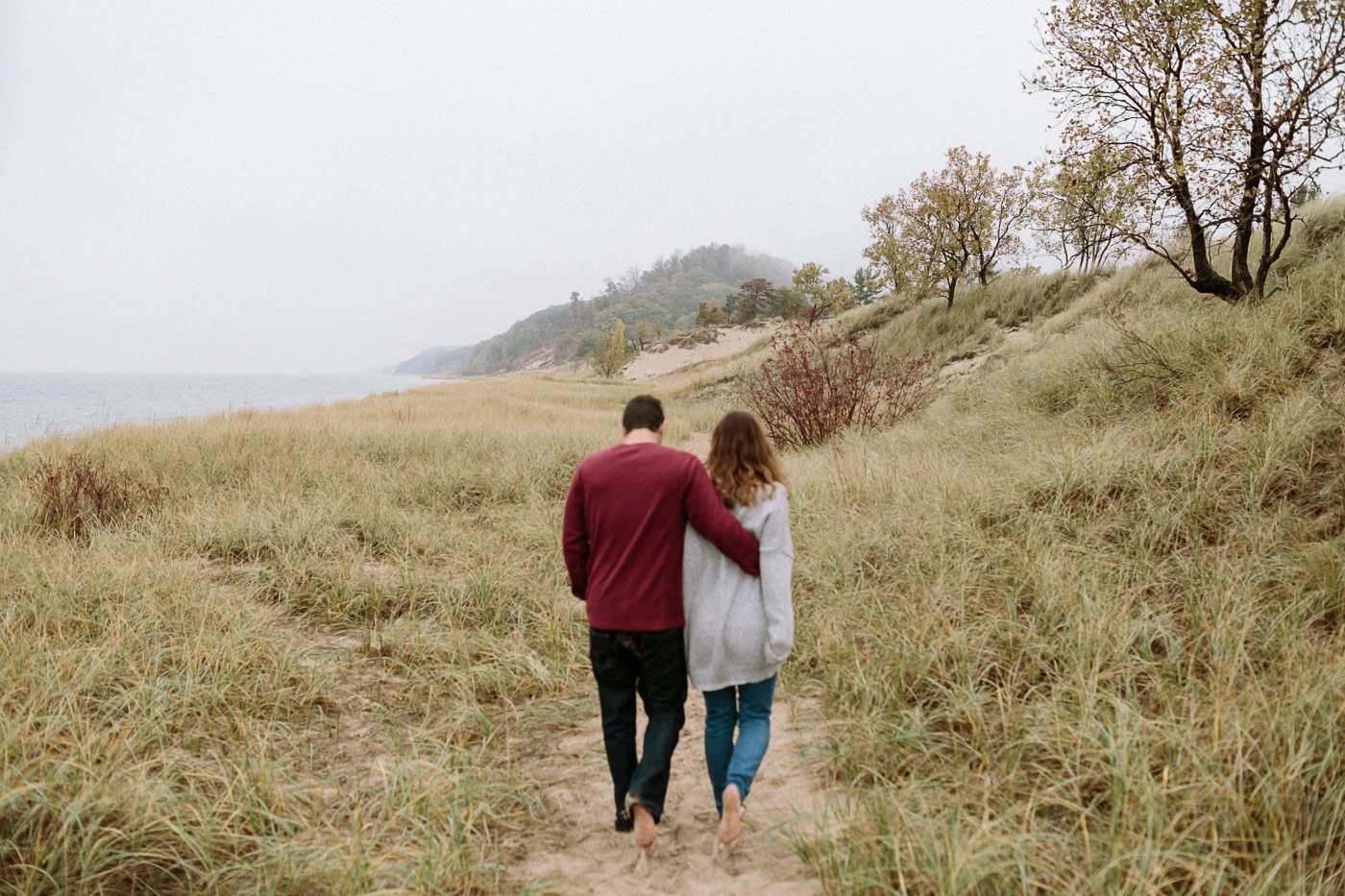 Couple walking along beach path