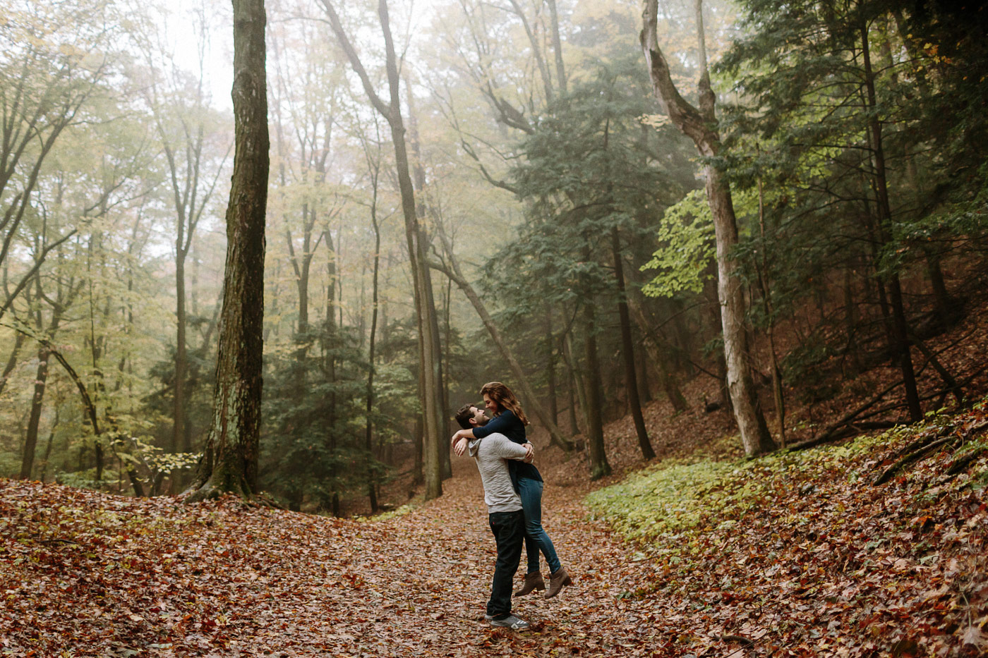 Couple embracing in foggy forest
