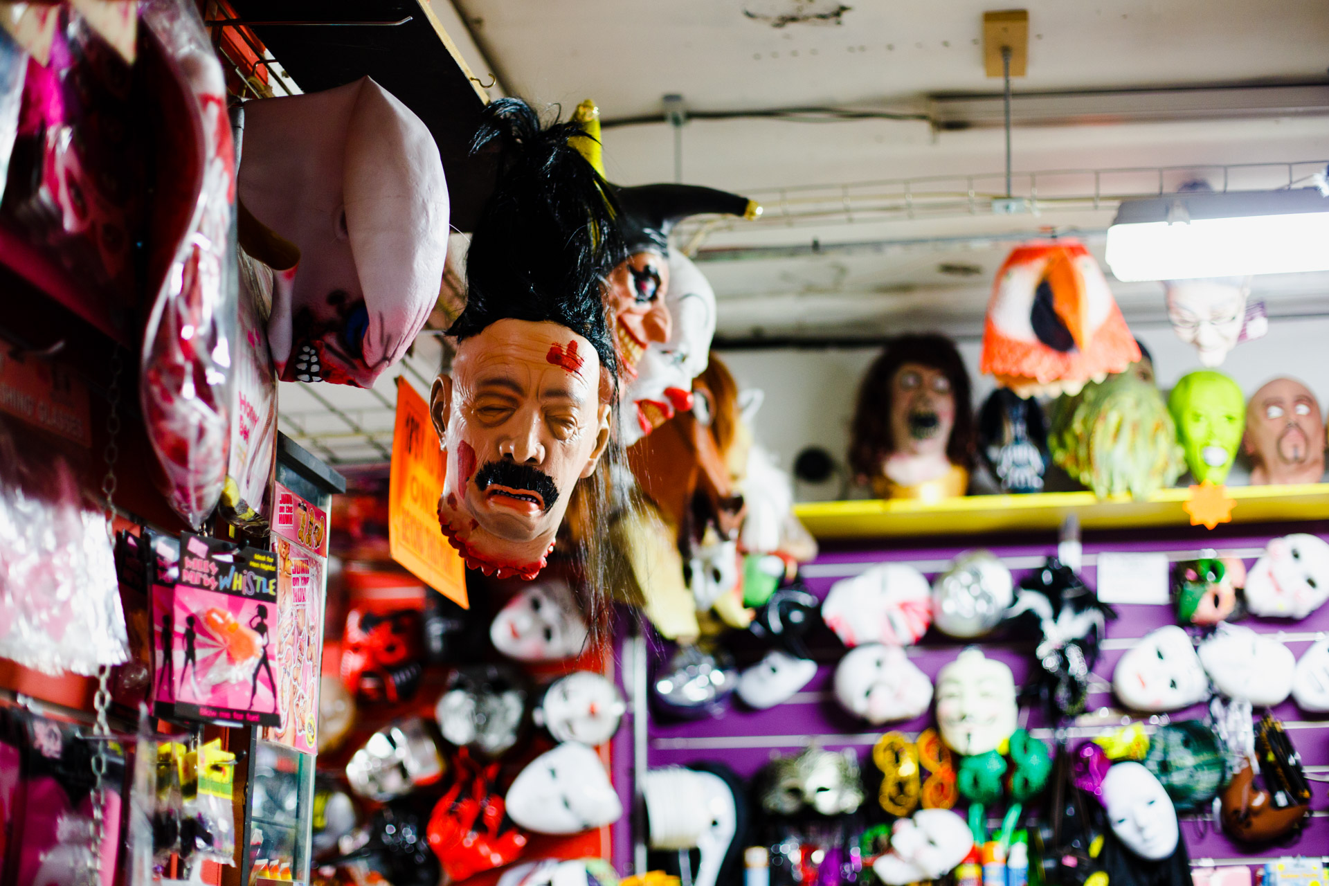 A mask hanging out in a mask shop.