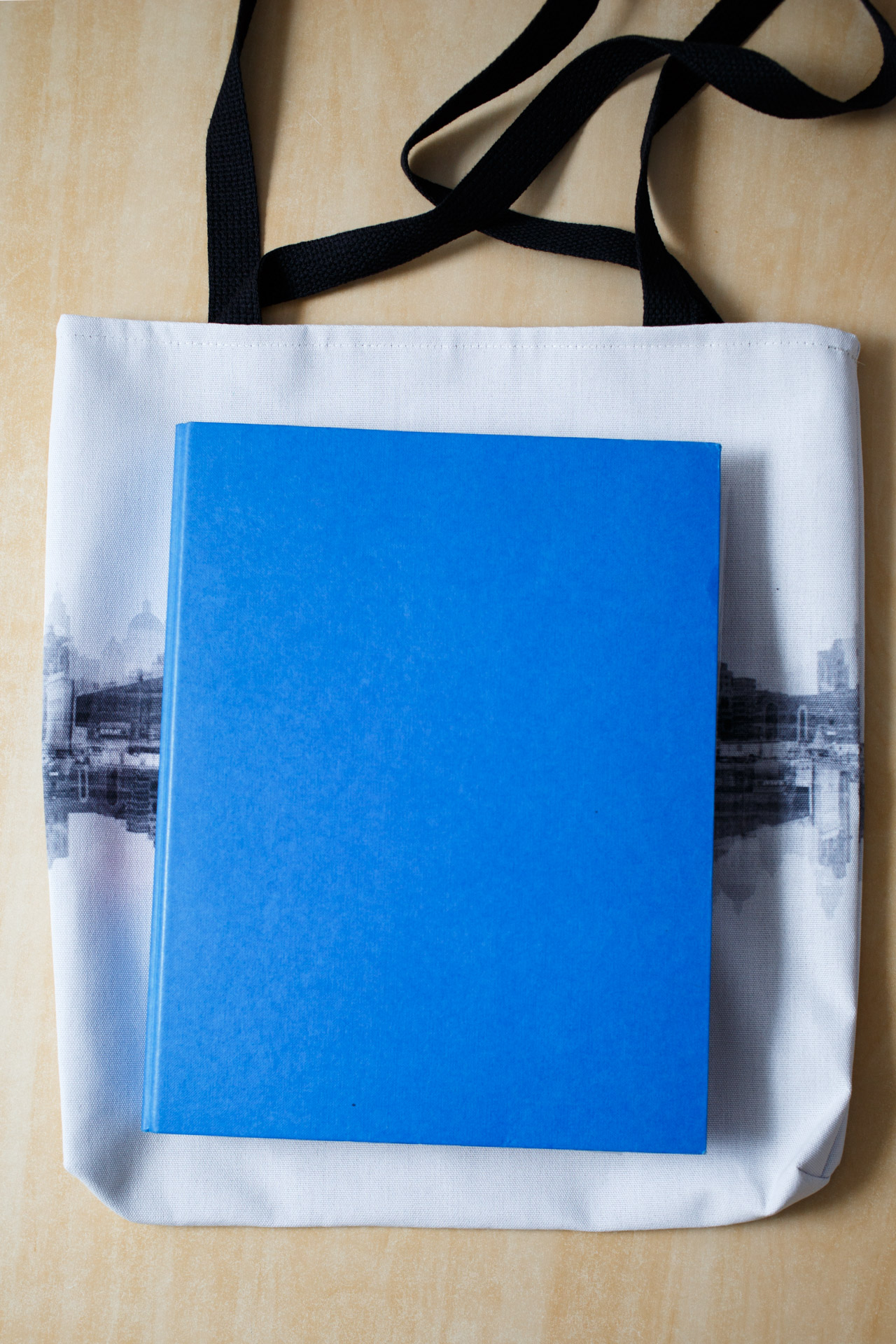 An A4 folder placed on top of the bag to give you an idea of size.