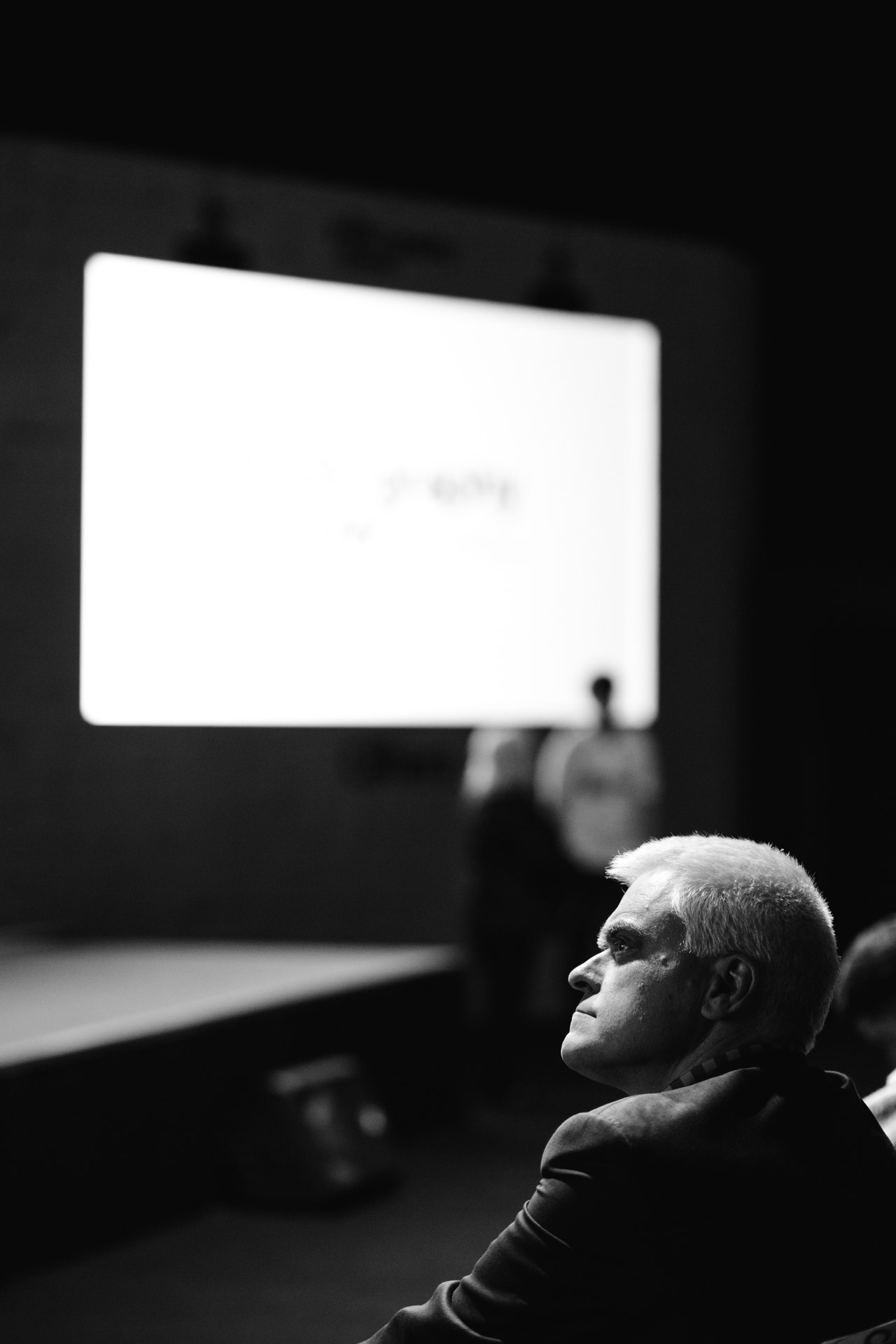Jon Bentley eyeing up the projection screens and lighting while waiting for Martin Parr's talk at the Super Stage.