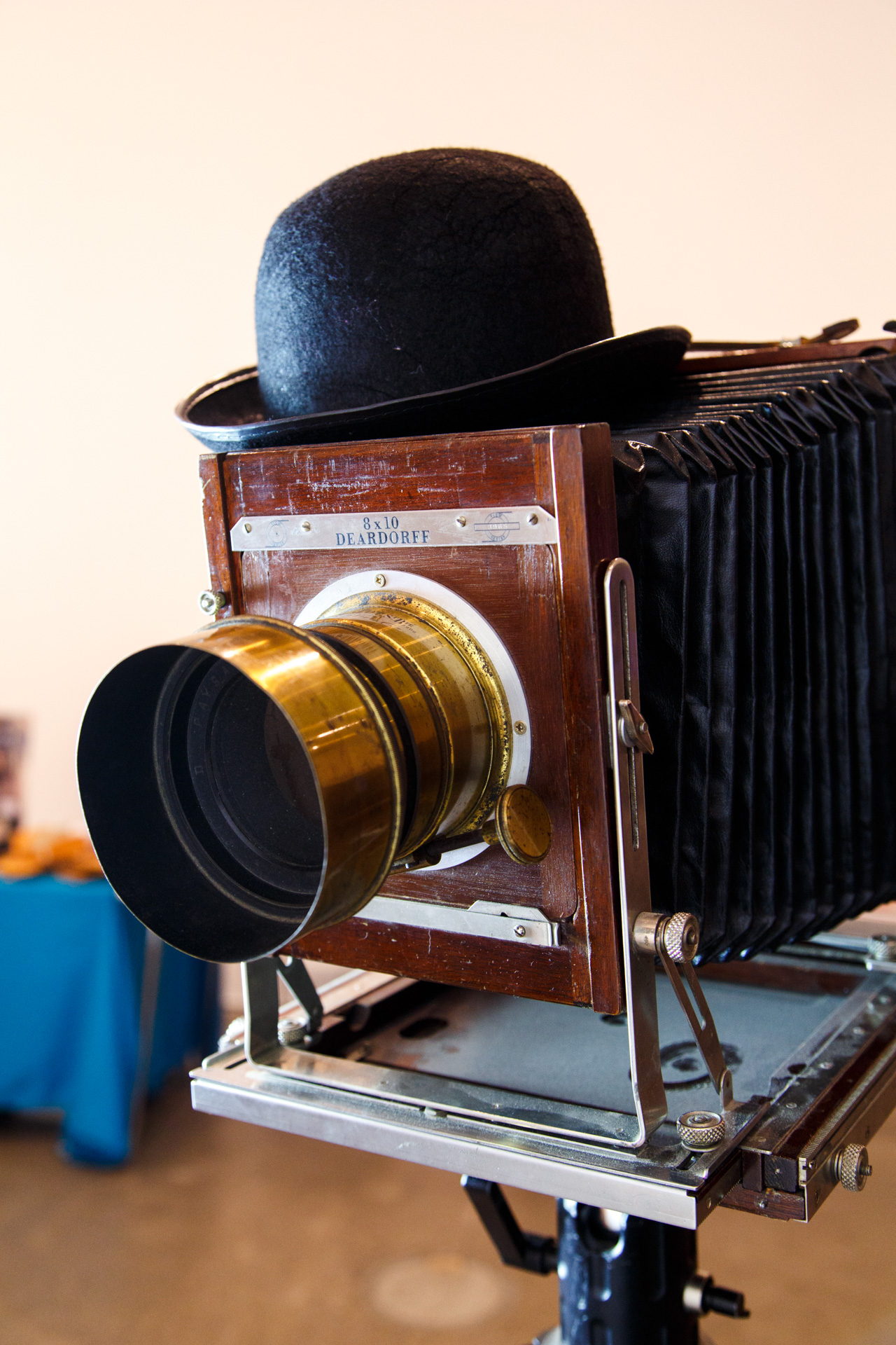 The hat is used as a shutter over the lens when the plate is exposed inside the camera.