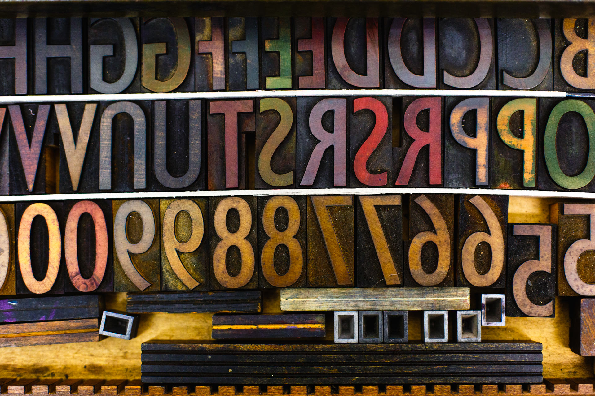 February -   The backwards arrangement of letters and numbers, coloured from use, made this one of my favourite photos that I took for the Liverpool letter-press print studio  Juniper Press .