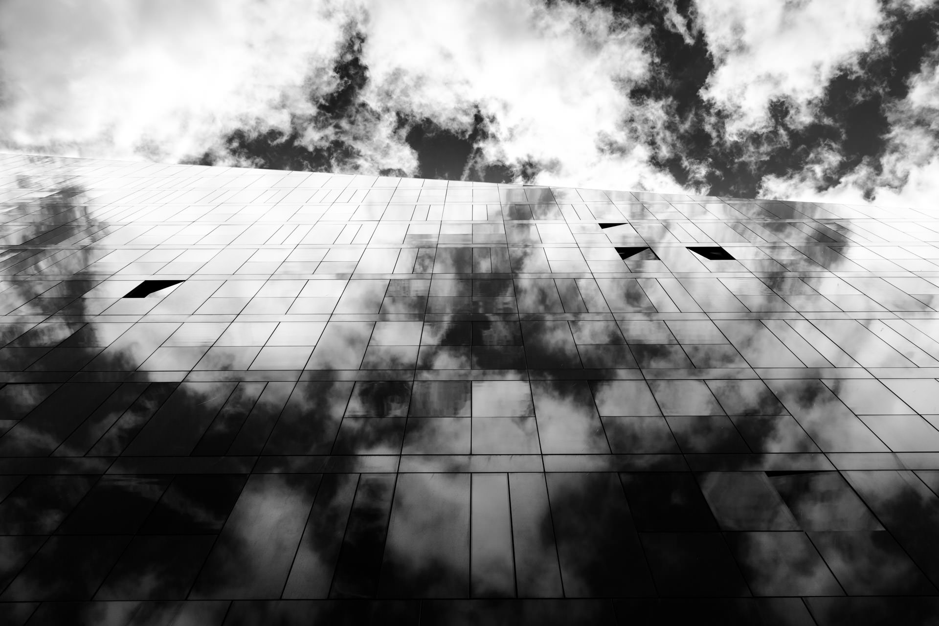 June - A cloudy reflection from the vast glass expanse of one of the  Mann Island  buildings.