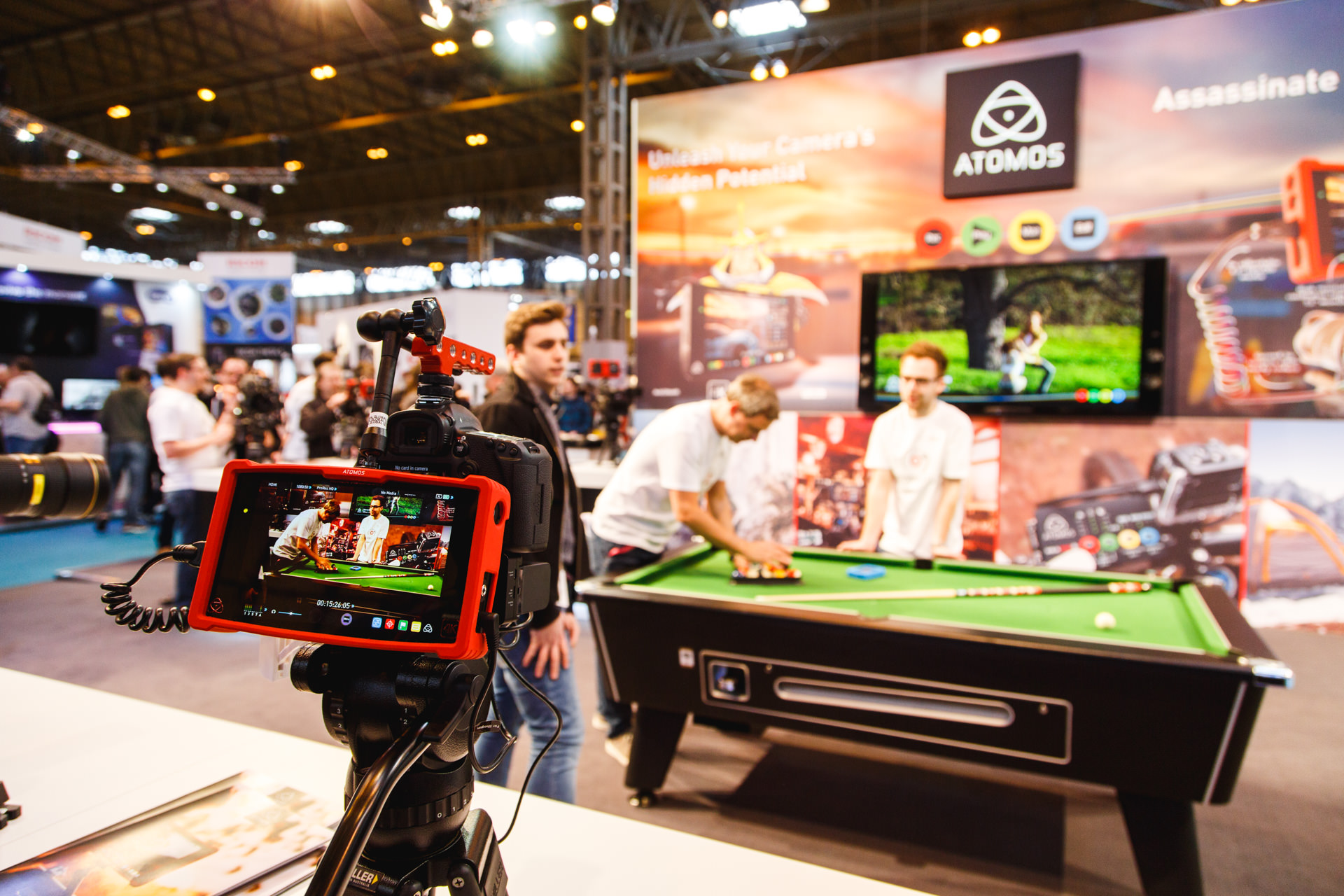 If I was shooting a lot of video then I would be investing in  Atomos products. Their combined monitor and recording-storage devices are quality, used by many a professional. Their stand setup surrounded a pool table, giving attendees an opportunity to see how the monitors looked when mounted to camera equipment.