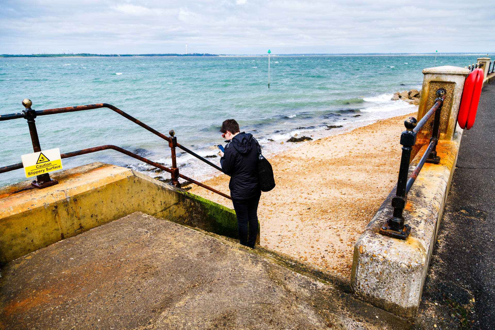 Han taking a snap of the rusted railings.