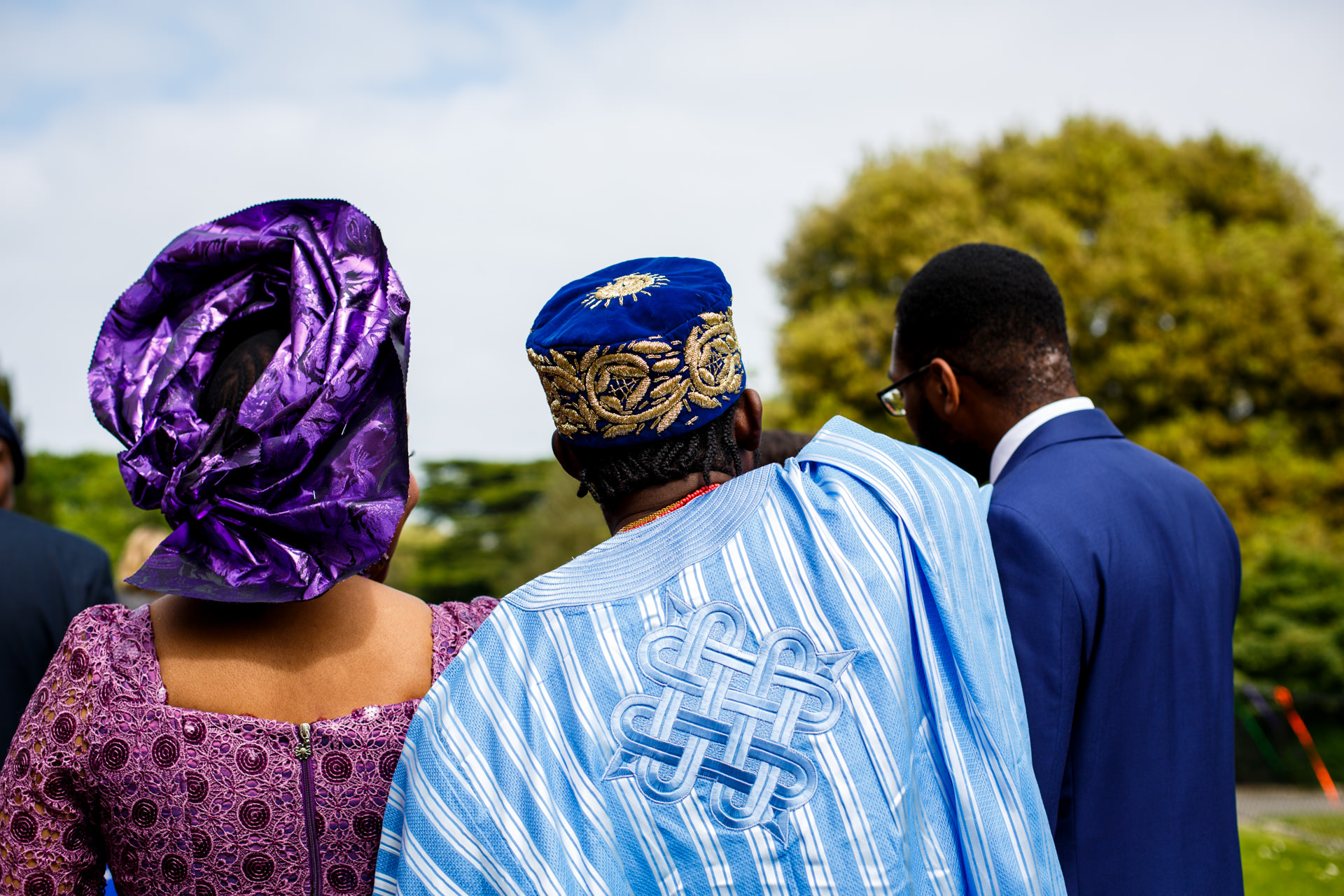 After the wedding ceremony: guests and Akosa (right) are intrigued by something...