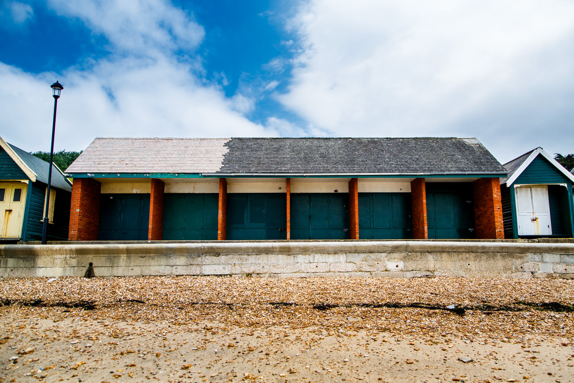 Beach huts line part of the Cowes coast.