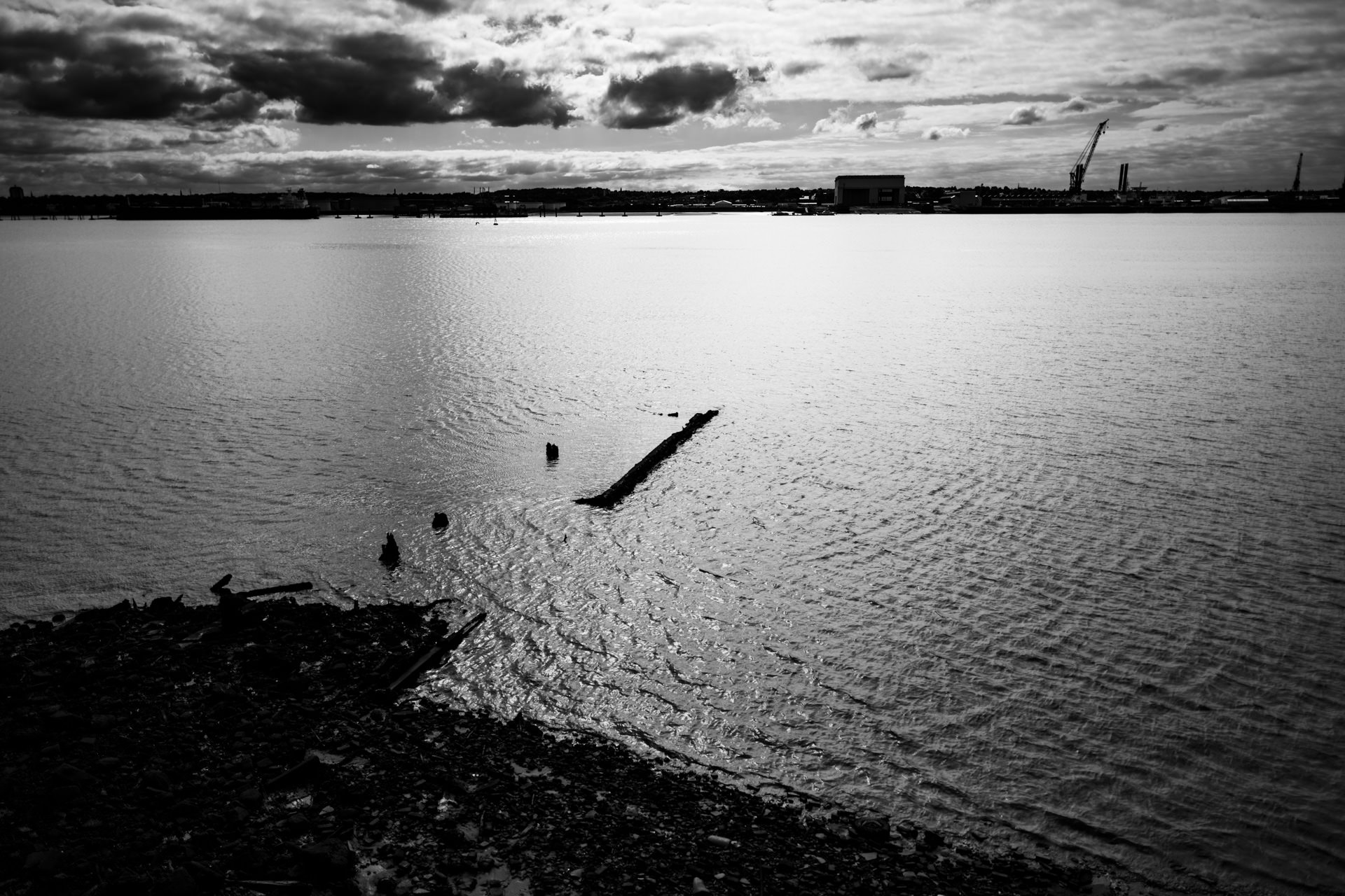 Old dock structures show up in the Mersey when the tide is out.