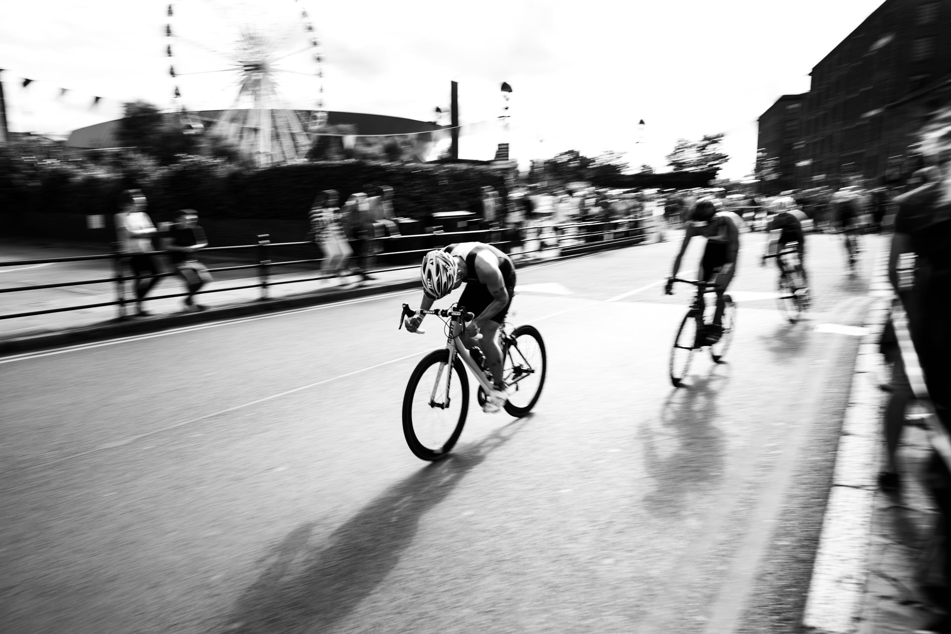 …we stumbled across the Tri Liverpool triathlon event. This cyclist digs deep to power out of the bend...