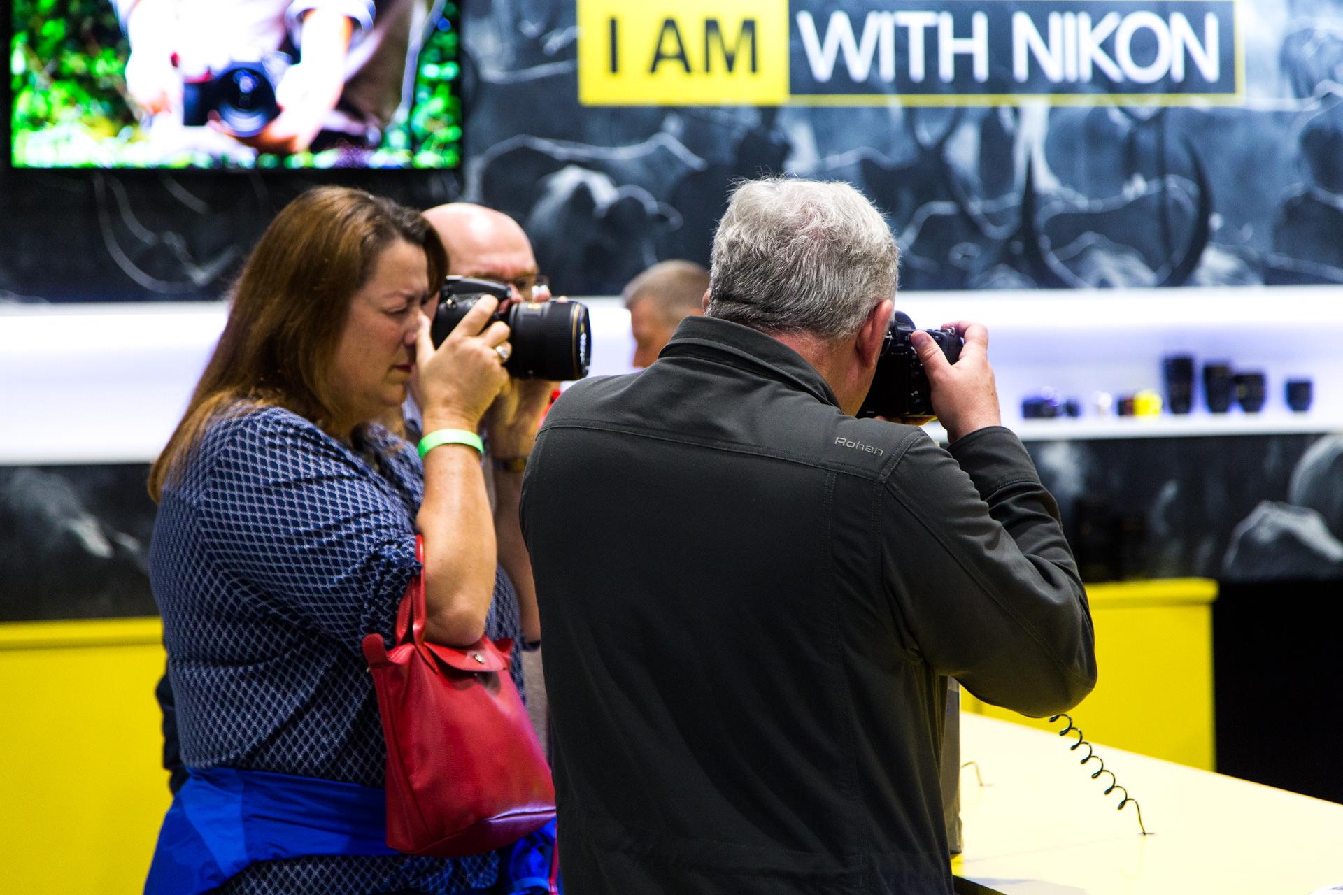Visitors trying out some of Nikon's cameras and lenses.