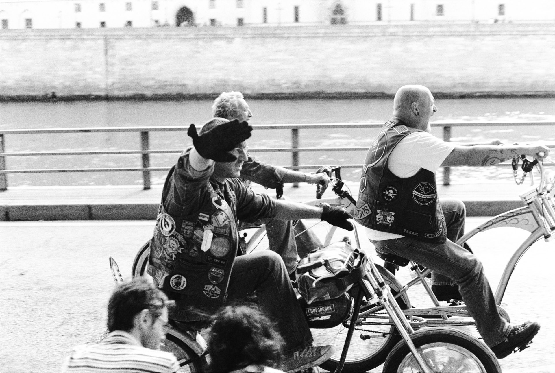 Andrew Wilson Photography Paris Cyclists Seine Laughing.jpg