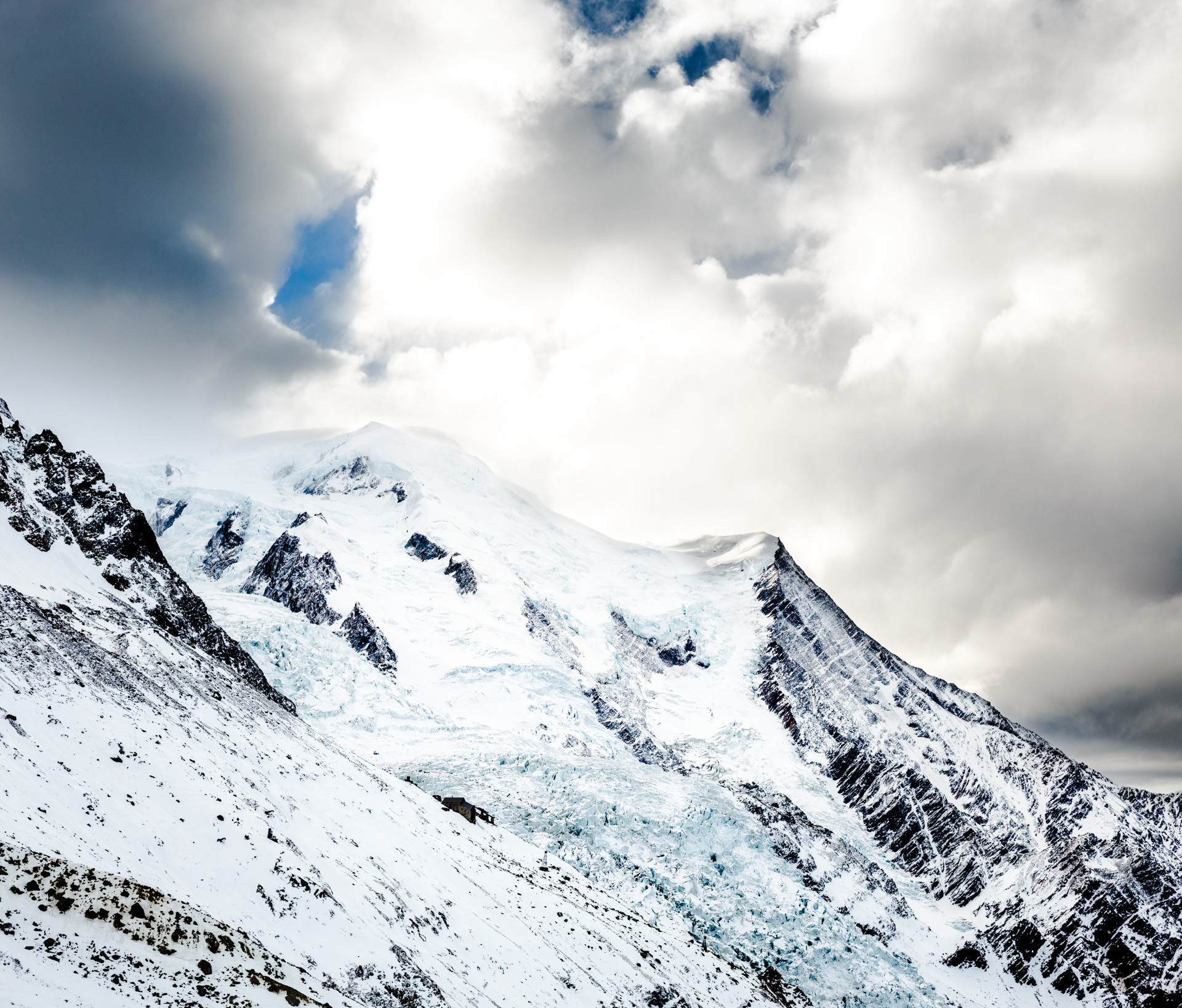 From left-to-right: Mont Blanc (hidden in cloud),Dome du Gouter (just visible) and Aiguille du Gouter.
