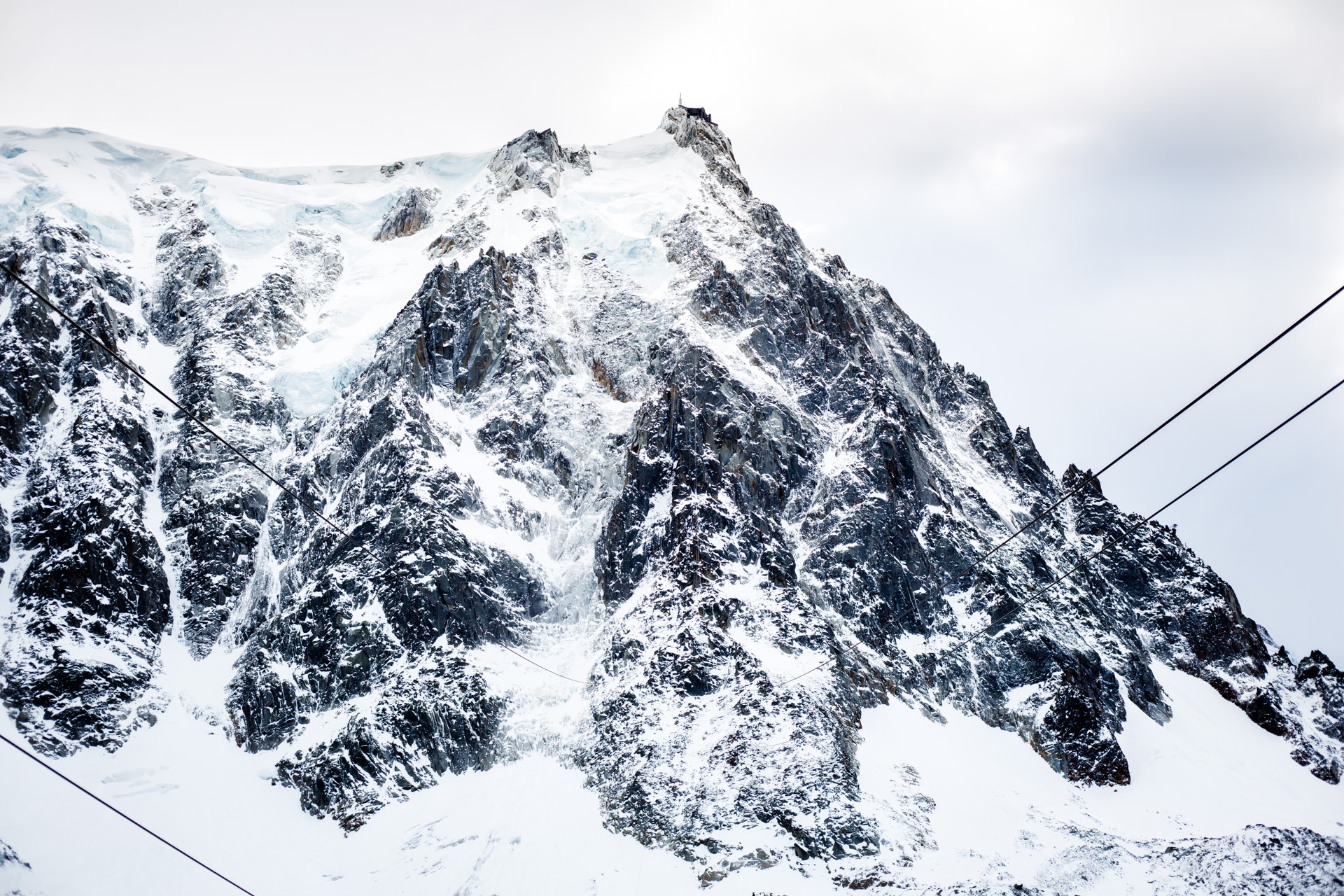 The Aiguille du Midi peak from the halfway point. The cables that guide the cable car dip before rising up to the peak.