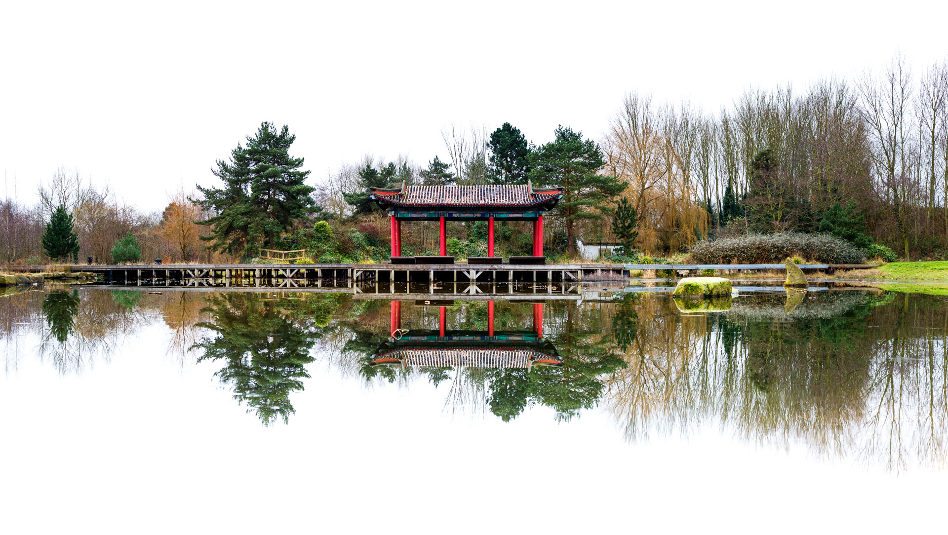 The way the frozen surface of the lake was allowed me to get a very still reflection. As there were no clouds or blue sky I decided to blow it out and go for a white background to allow the pagoda and trees to stand out.