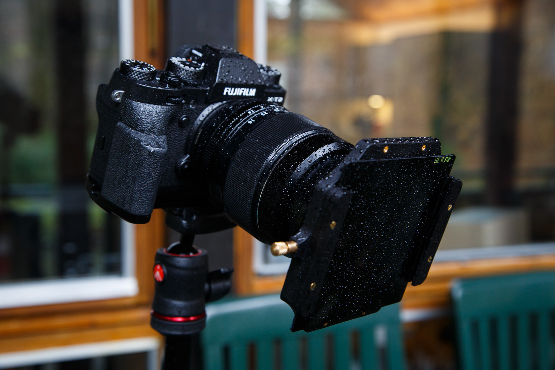 My Fuji X-T2 with the LEE Big Stopper mounted on the front (looking a bit wet!).