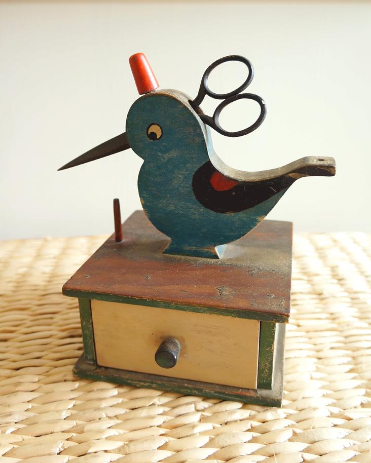 blue sewing bird