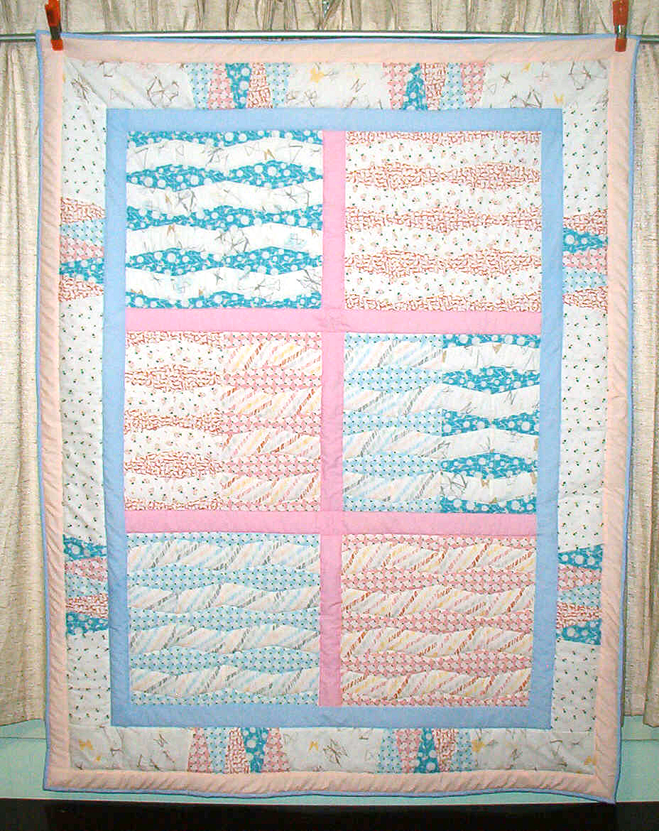 Baby quilt designed and made by Phil Clark using Gossamer fabrics by Sharon Holland from Art Gallery Fabrics