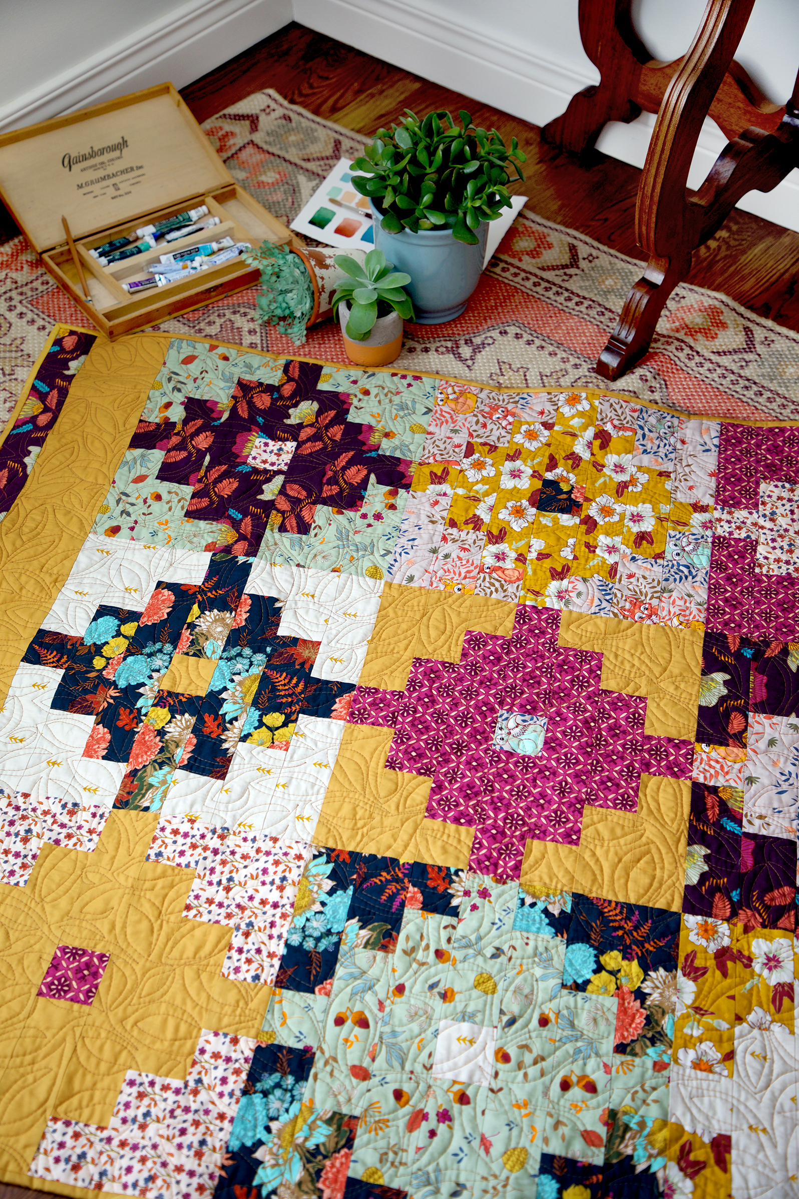 Wild Honey quilt on floor small.jpg
