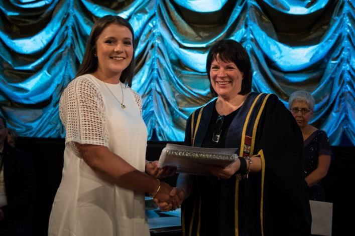Sophie being presented the award by Professor Harlene Hayne, Vice-Chancellor at the University of Otago.