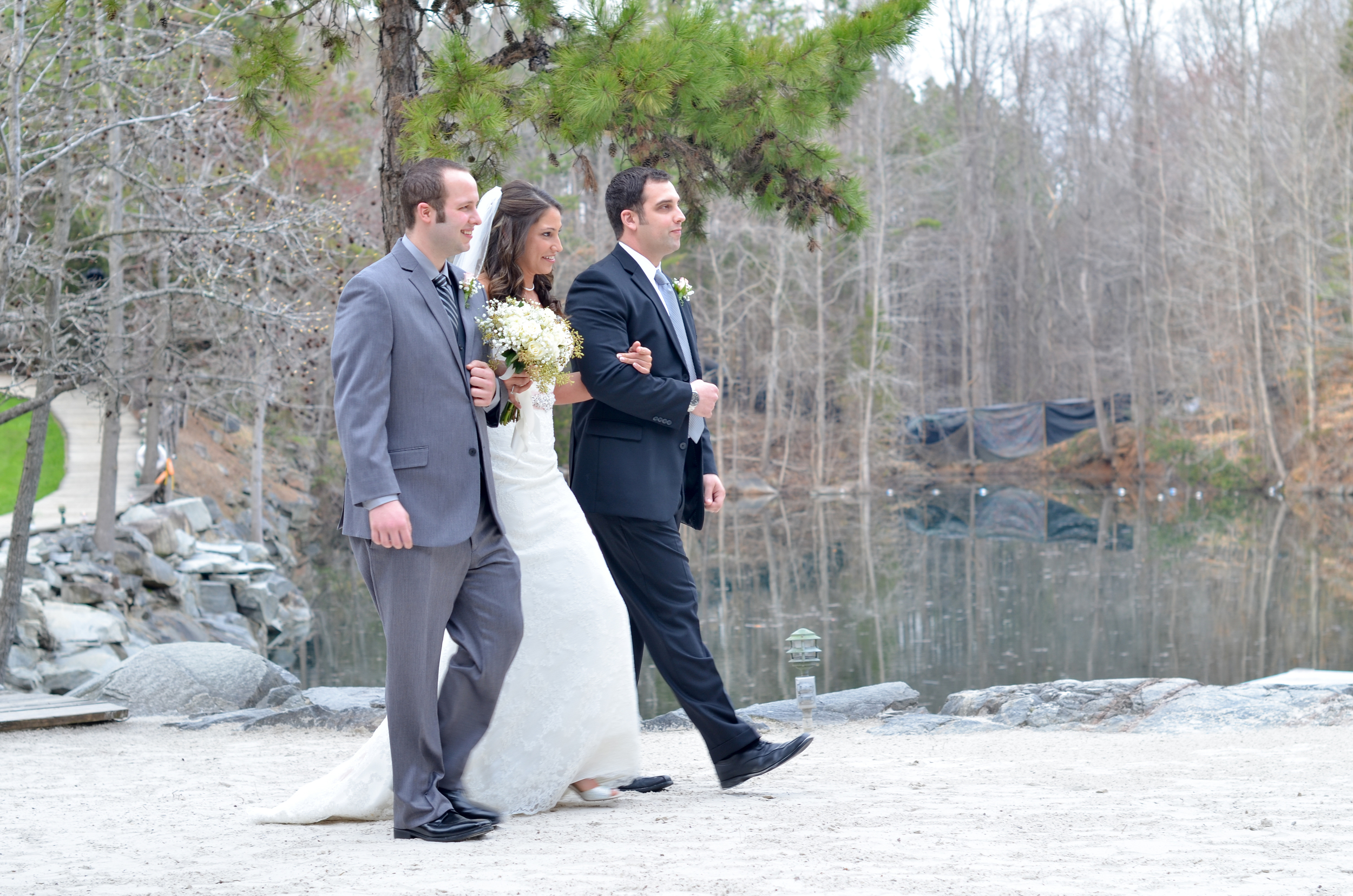 This wedding was really unique in that the bride's father was the officiant. So in a change from tradition, her two brothers walked her down the aisle towards both her groom and her father. I loved it!