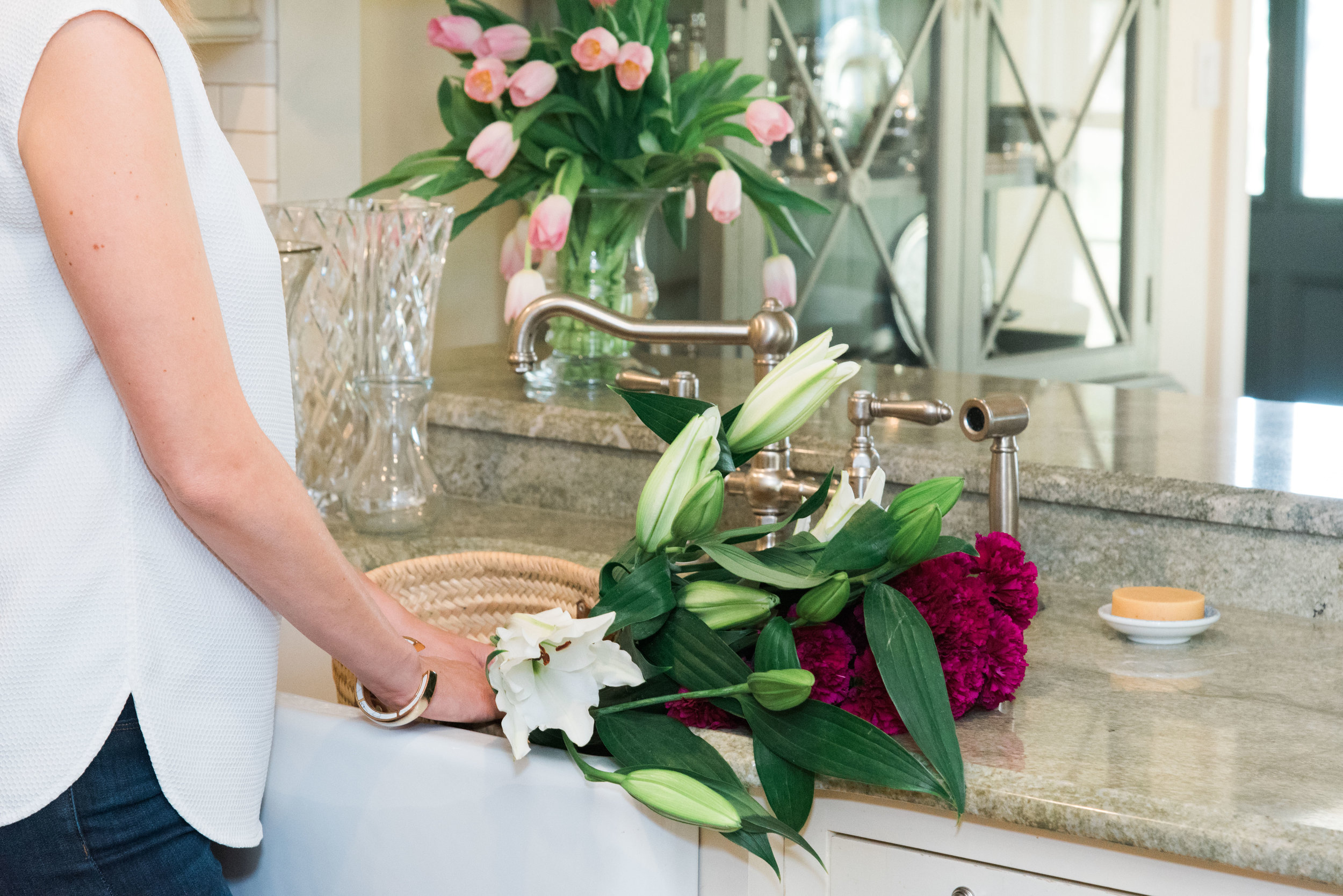 This house is all about understated elegance. To bring in color and texture, we opted for simple stems in fancy vases.