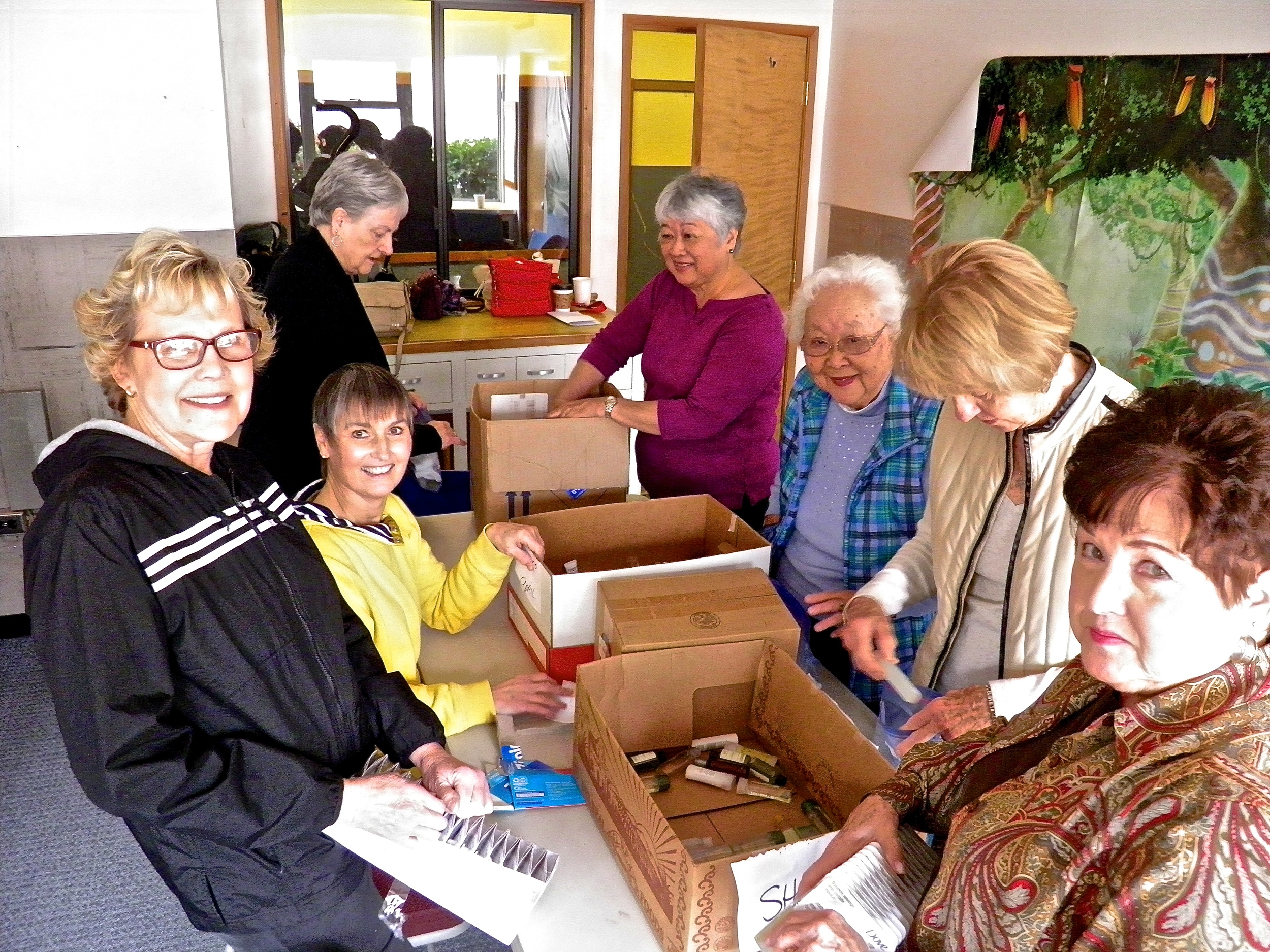 Women assemble hygiene kits for homeless men, women, and children.