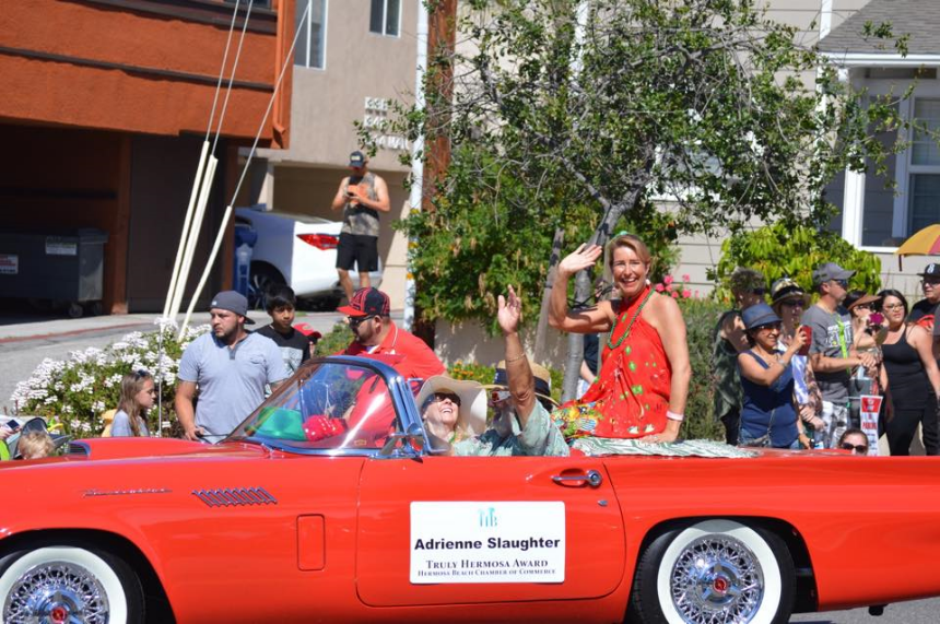 """Honored to be Special Guest in 2015 St. Patrick's Day Parade in Hermosa Beach, CA, Adrienne Slaughter waves as the """"Truly Hermosa"""" Award Recipient."""