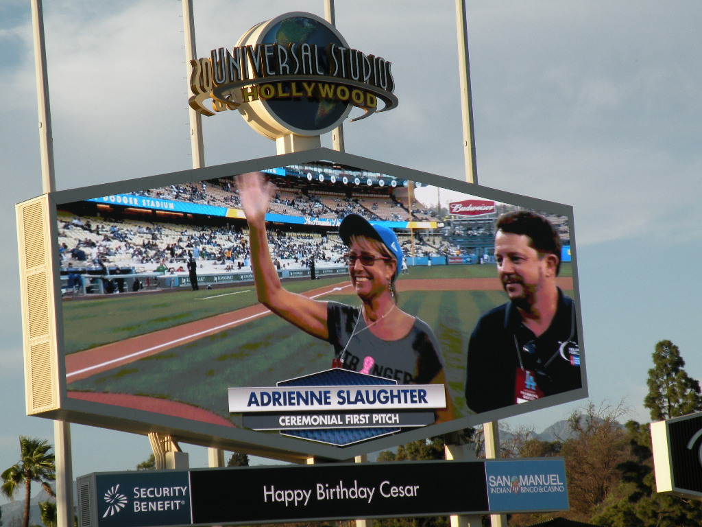 Adrienne Slaughter, seen on the Megatron, thanks the cheering fans after tossing the Ceremonial First Pitch at Dodgers' Stadium on May 1, 2015, as American Cancer Society's 2015 Hero and Voice of Hope.