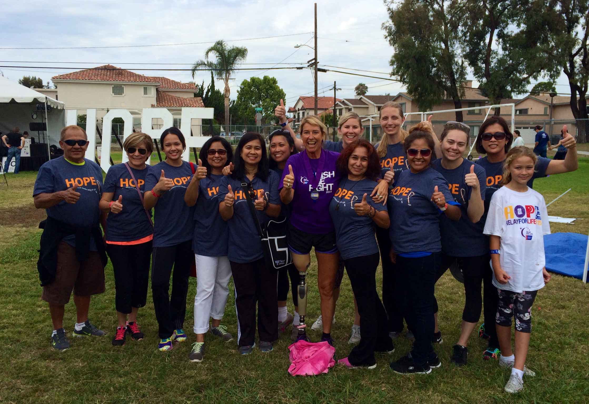 2015 Hero and Voice of Hope Adrienne Slaughter with the Providence Little Company of Mary team at Beach Cities Relay For Life on 7/18/15.