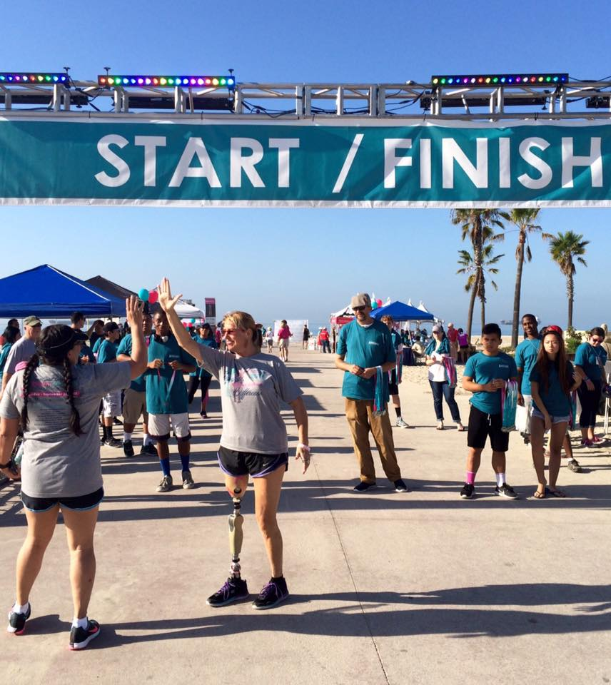 Emcee/ Keynote Adrienne Slaughter high fiving a runner at Finish Line at 16th Annual Team Spirit 10k/5k Breast & Ovarian Cancer fundraiser for Memorial Medical Center Foundation in Long Beach, CA on September 26, 2015.  http://lbpost.com/life/health/2000007214-team-spirit-long-beach-brings-community-together-to-support-breast-ovarian-cancer-awareness#.Vg8StmEi_jA.gmail