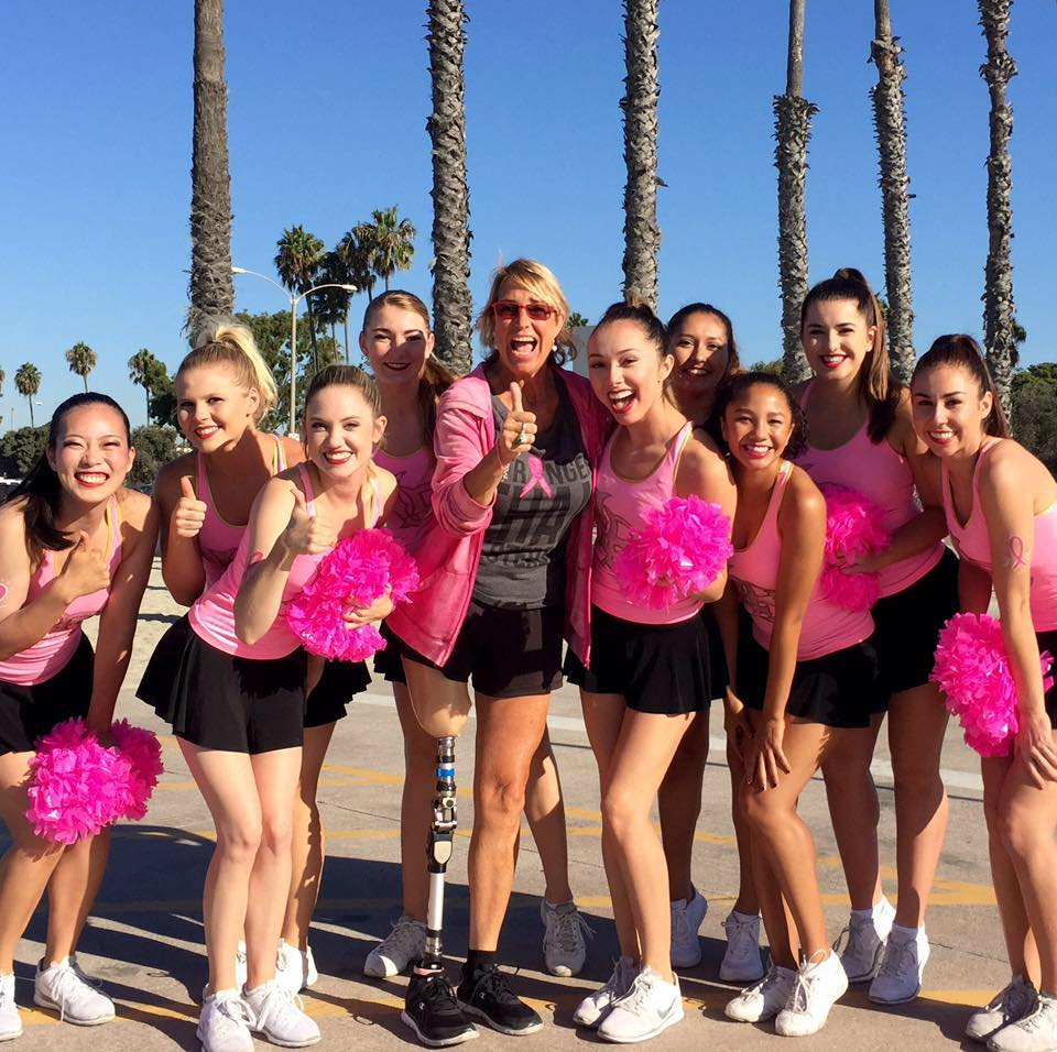 "On 9/26/16, Ms. Slaughter emceed this Memorial Medical Center Foundation Team Spirit 5K fundraiser for the 4th year in a row. Seen here with Long Beach State cheerleaders after Adrienne ""high-fived"" and congratulated every participant at the finish line at Granada Beach/Belmont Shore area of Long Beach, CA."