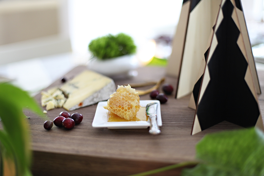 That beautiful honeycomb is covered single-source honey from  Ames Farm  in Minnesota.Beekeeper Brian Fredericksen is actually running a  Kickstarter  campaign right now to build an energy-efficient honey house for his bees — pretty sweet. P.S. Why haven't we been putting honeycombs on all our  cheese plates  since the beginning of time?