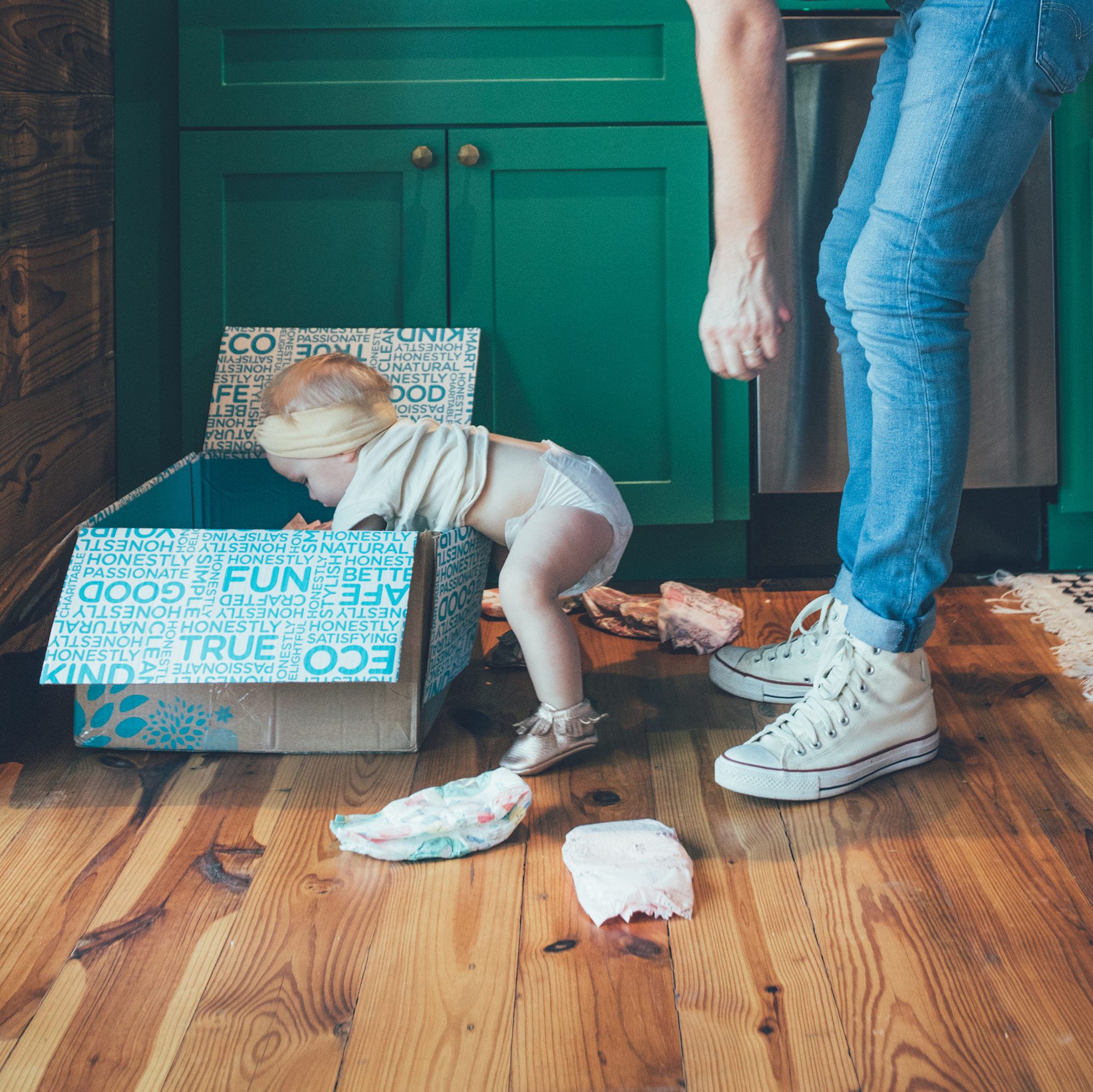 'We have baskets filled with toys everywhere, and she's happy with a box and some crinkle paper.  Couldn't resist capturing this busy toddler in her element on our shoot day.' -