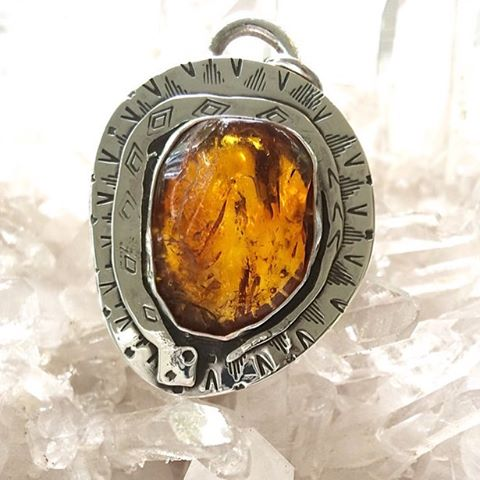 Finished up this sweet Amber snake amulet for one of our buddies. #fossilandhide #amber #amulet