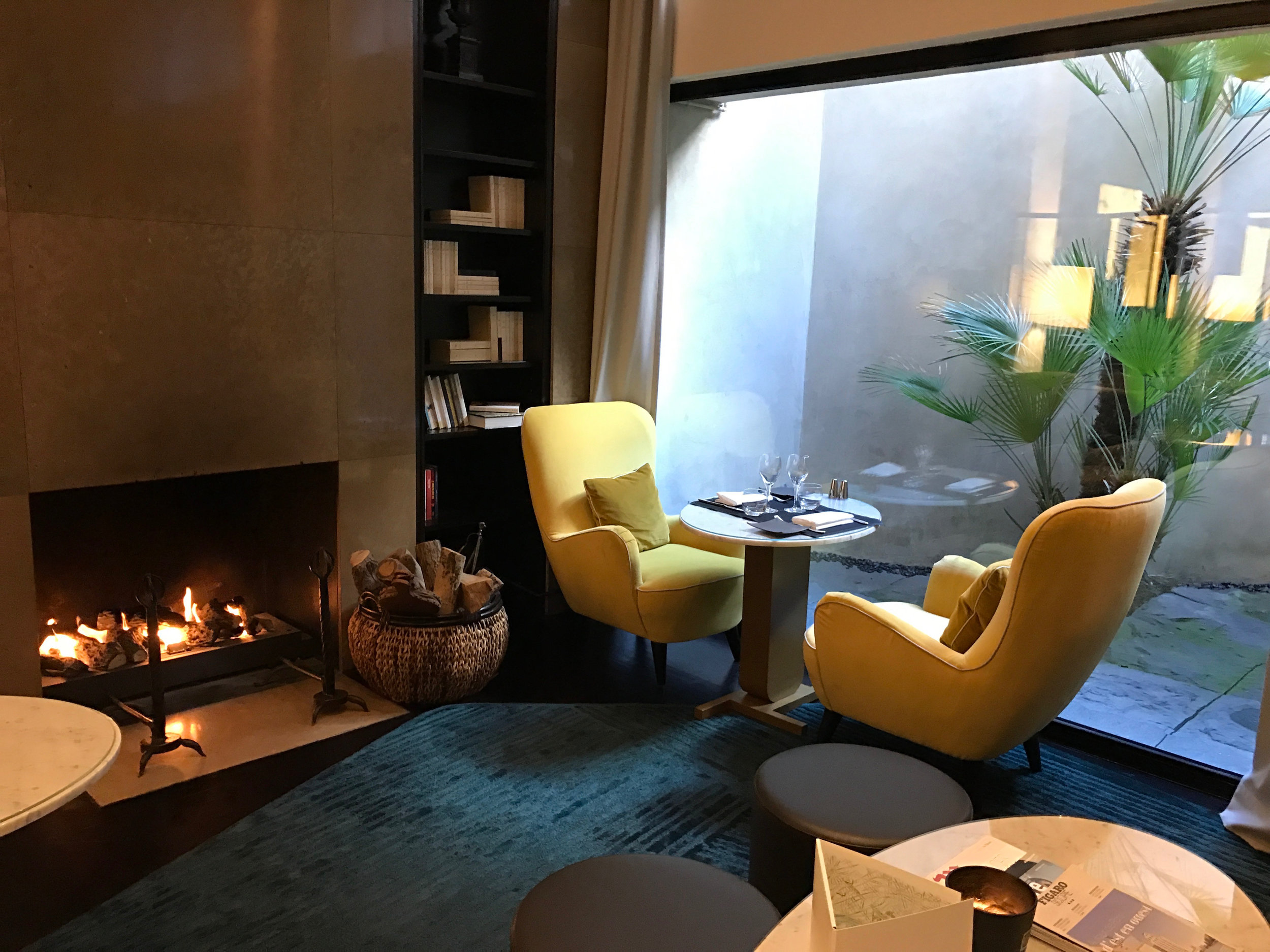 Relax at the fireplace at a Preferred Hotel