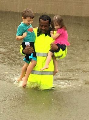 "From   Des Moines Register  : ""Sheriff's Deputy Rick Johnson carries 2 children from heavy flooding 8/27/2017. A colleague snapped this photo as Tropical Storm Harvey slammed into the Houston area."""