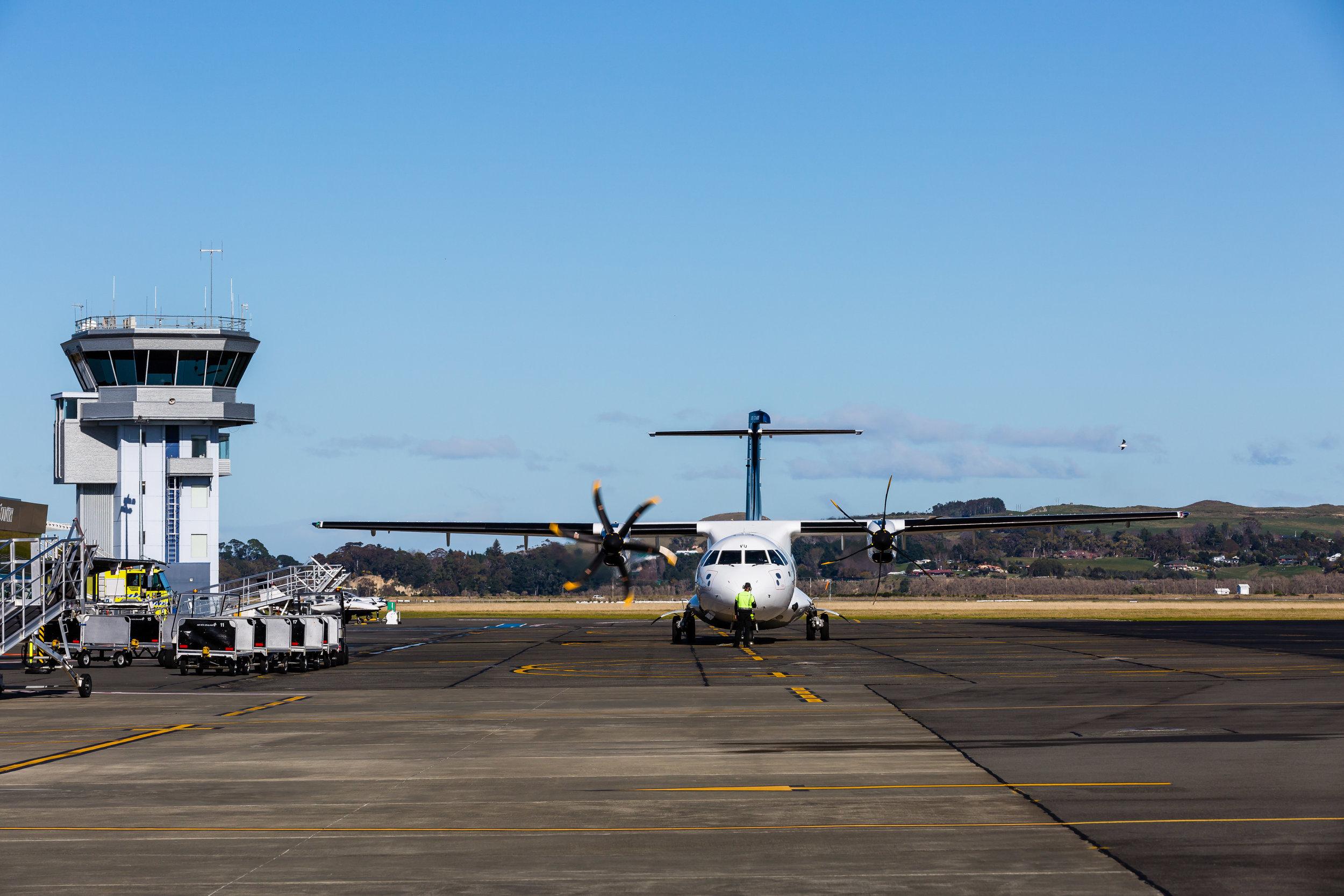Air New Zealand aircraft arriving at the terminal