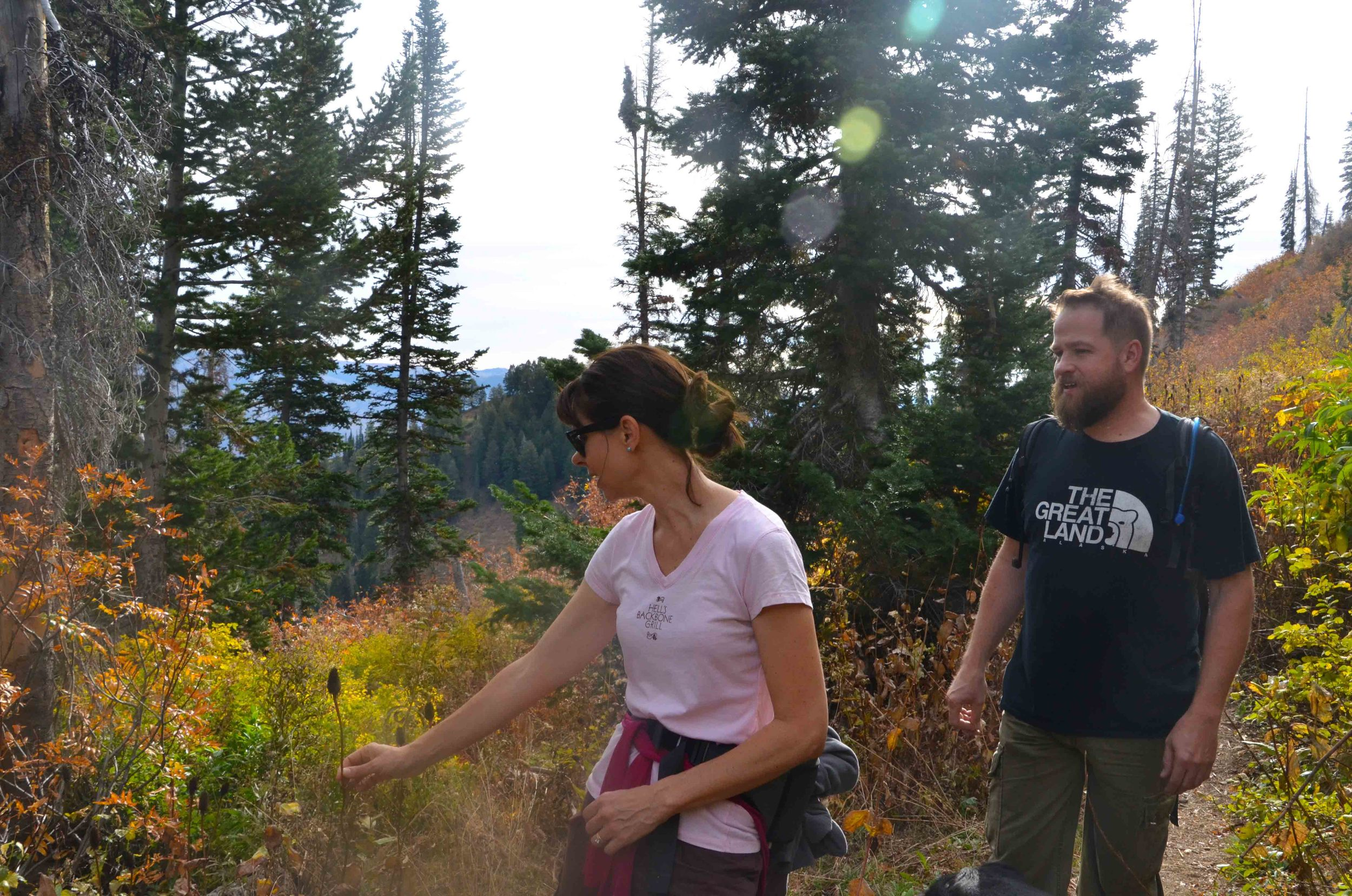 Brandi with the Ogden Nature Center explaining different types of flowers to Todd to the Top