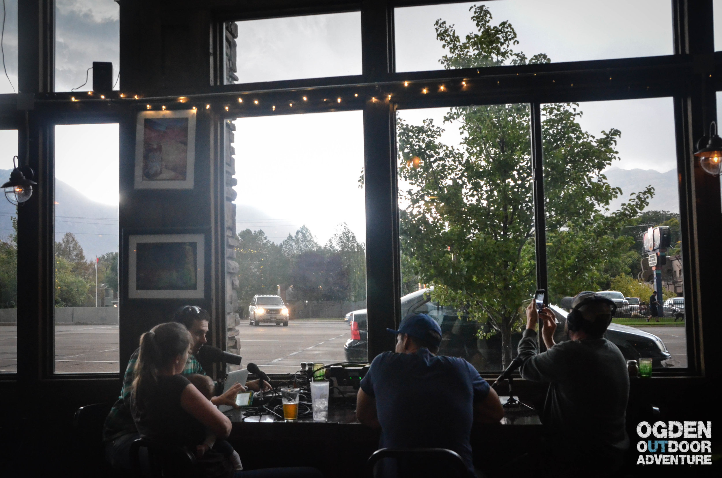 Podcasting at Slackwater Pizzeria while a storm rolls in.
