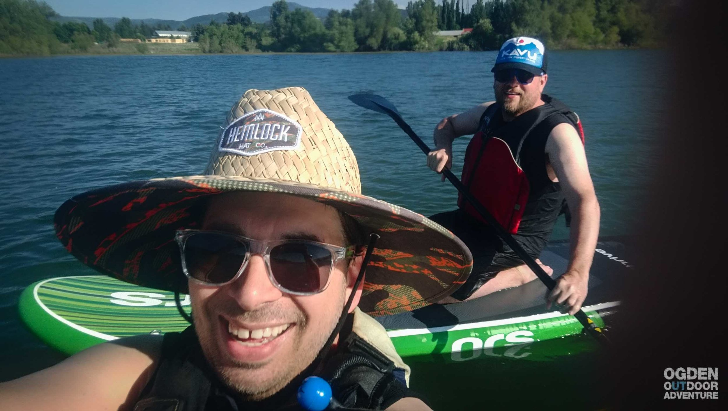 Us SUP'ing. Oh, and I LOVE my new Hemlock hat!! It sometimes bumps against with my pfd, but otherwise, it's perfect for deflecting the sun.