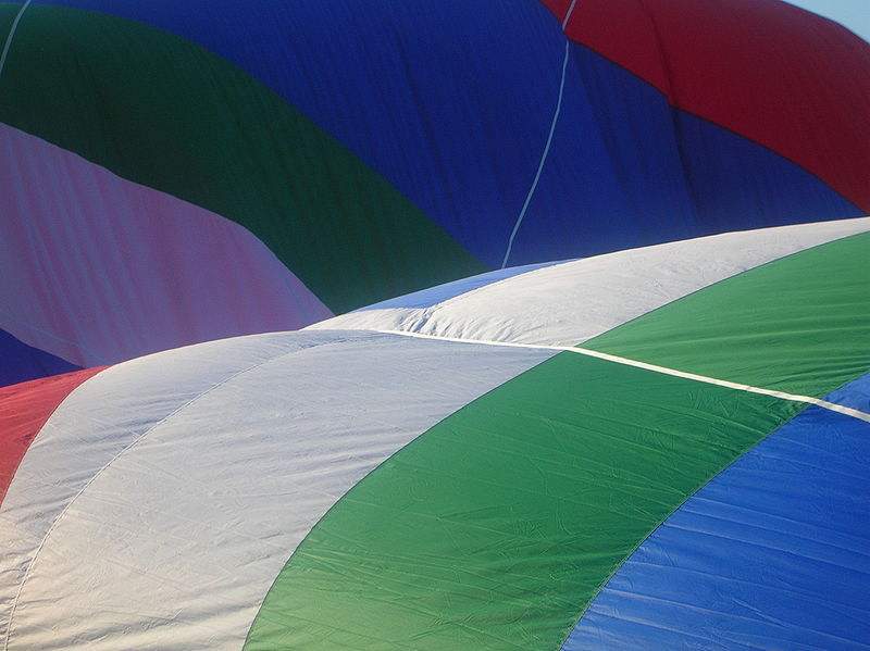 Color constancy: The colours of a hot air balloon   are perceived as being the same in sun and shade while we are on location, but does the final photograph allow us to perceive them as the same? (Image source: Wikipedia)