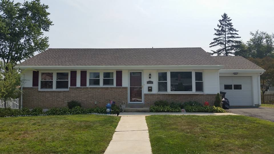 At this home we installed all new vinyl siding, architectural shingles, vinyl shutters, and seam less gutters.