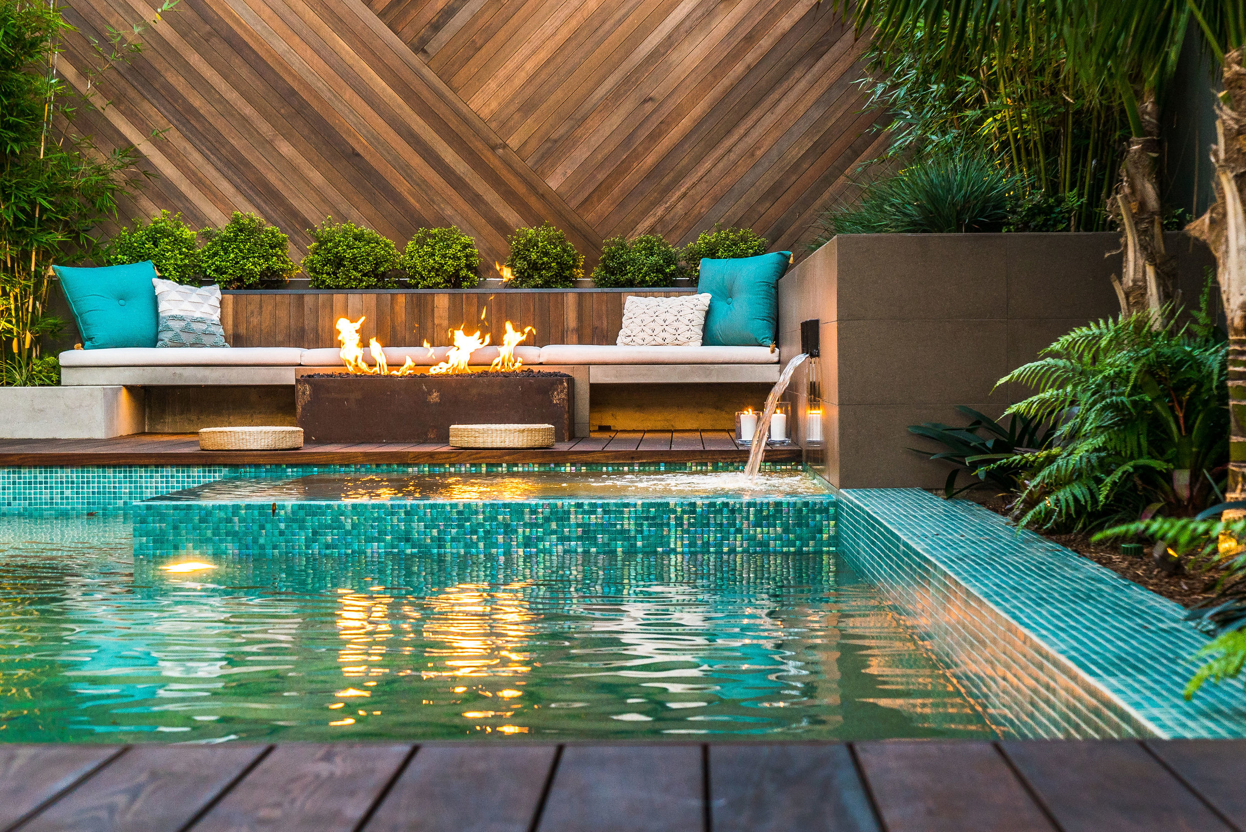 PC: Brett Hilton  As you see above the warm colors of the wall, fountain/planter, and fire feature, were delicately balanced with green plantings and teal accents.  Click for more imagery!!