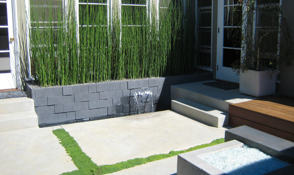 Without this green wall there would be a lacking of color and soft elements to the space.