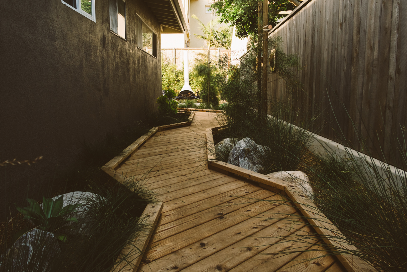 Low-impact boardwalk is gentle on the site and feels immersed into the landscape. There is something about walking on a boardwalk, is it the sound? the feel? If possible it is a great alternative to concrete.